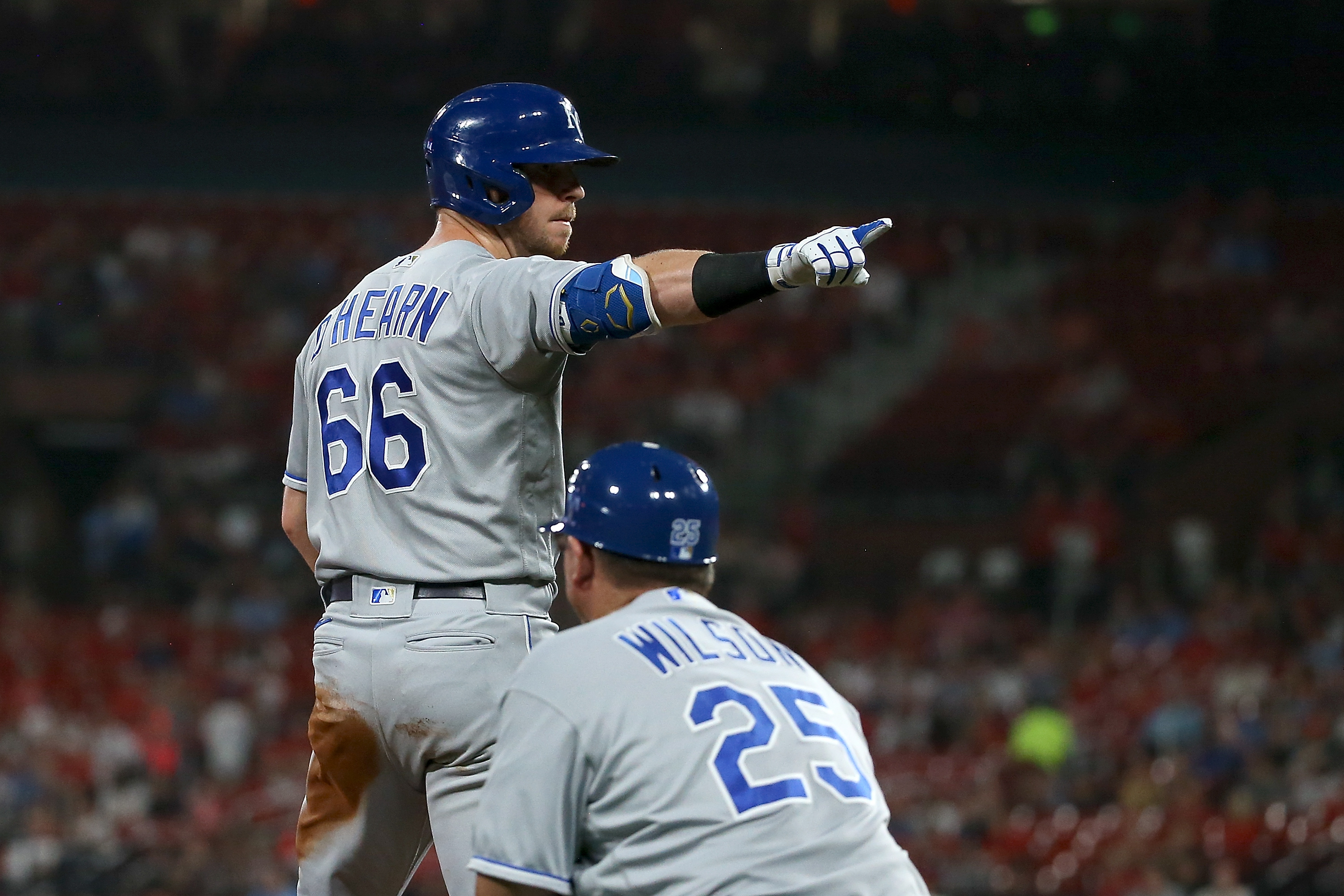 Ryan O'Hearn #66 of the Kansas City Royals points to the dugout after hitting a RBI triple during the sixth inning against the St. Louis Cardinals at Busch Stadium on August 6, 2021 in St. Louis, Missouri.