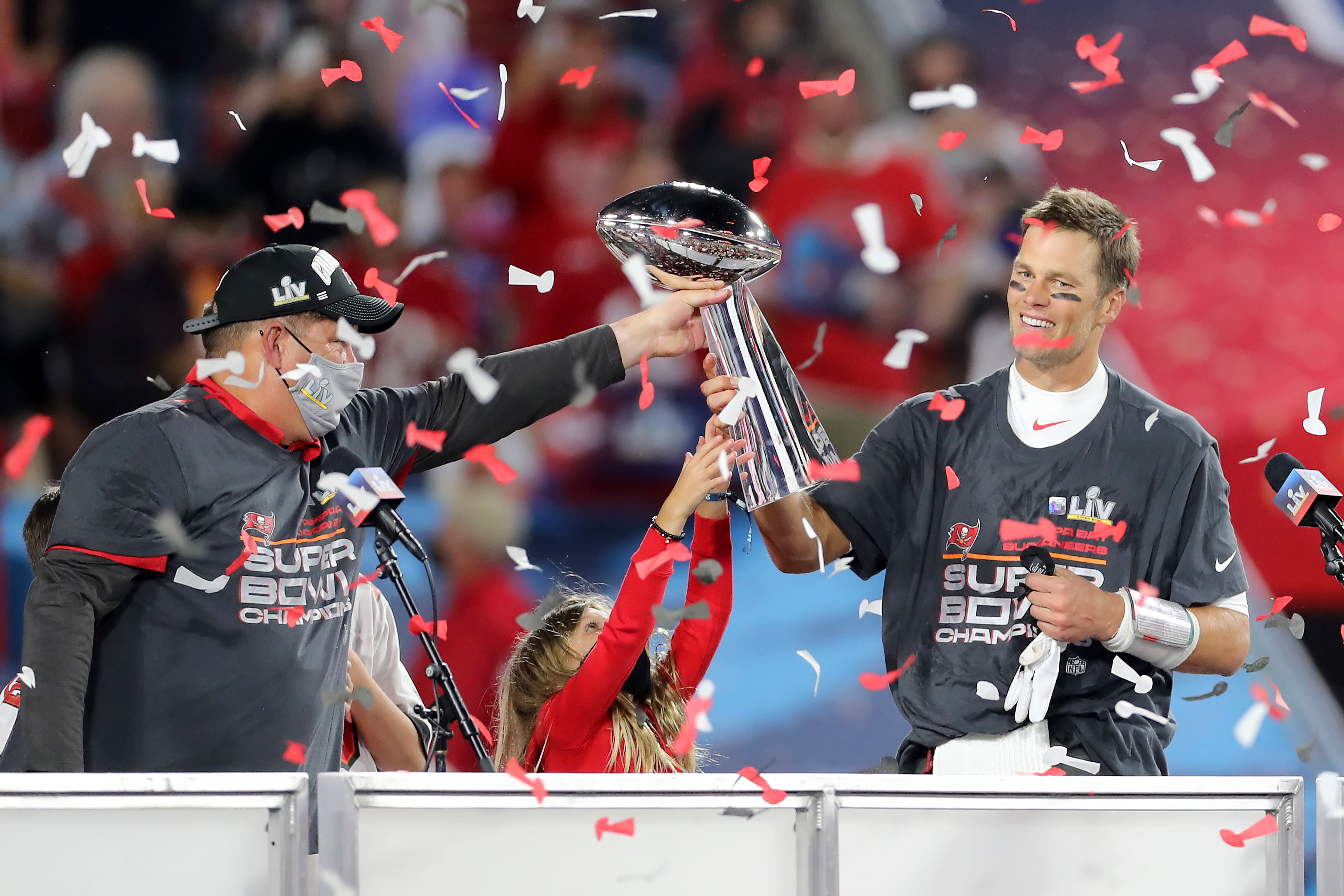 Super Bowl MVP Tom Brady (12) of the Buccaneers accepts the Lombardi Trophy from General Manager Jason Licht after the Super Bowl LV game between the Kansas City Chiefs and the Tampa Bay Buccaneers on February 7, 2021 at Raymond James Stadium, in Tampa, FL.