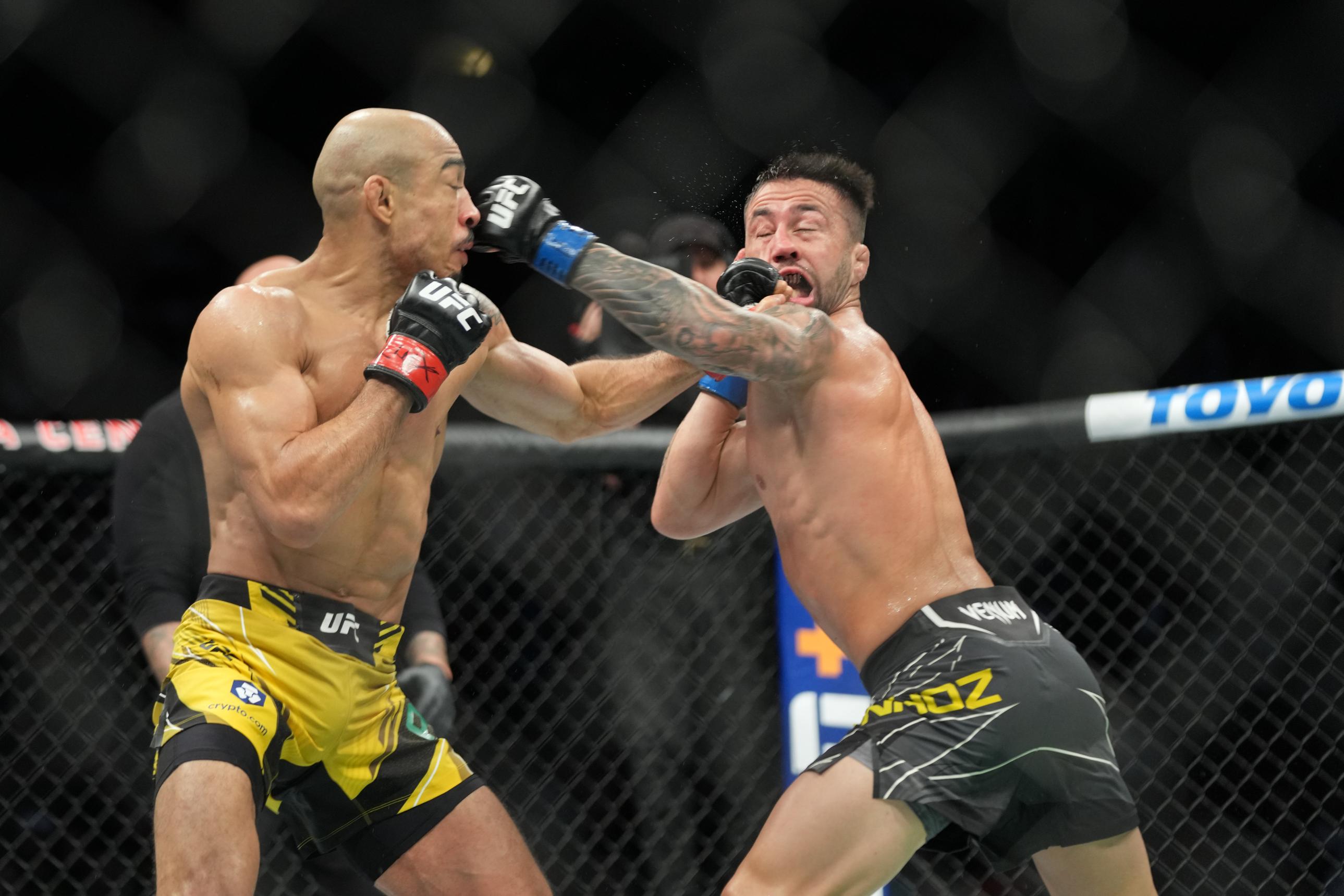 Jose Aldo lands a left hook on Pedro Munhoz at UFC 265 in Houston, TX.