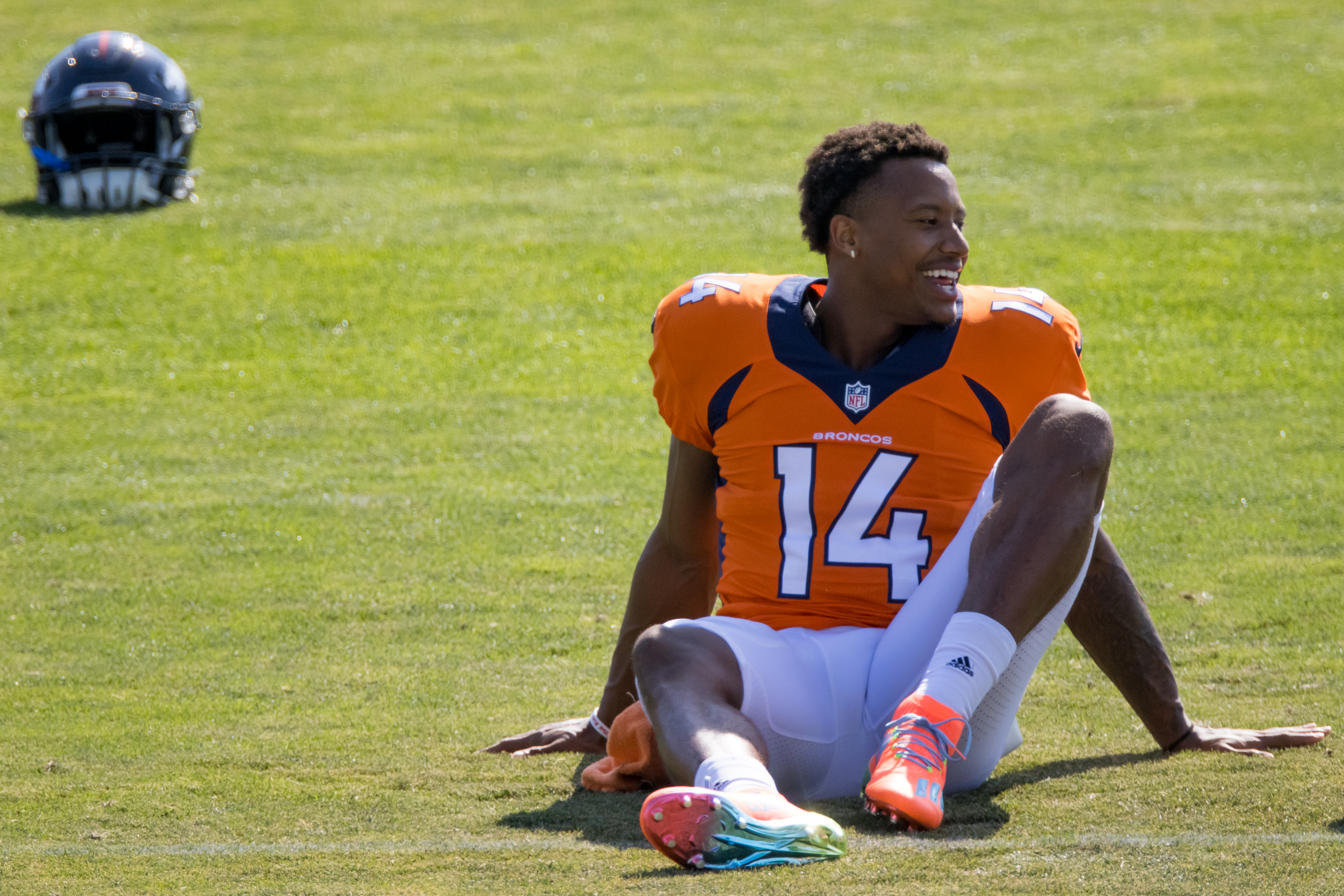 Wide receiver Courtland Sutton #14 of the Denver Broncos smiles while stretching during a training session at UCHealth Training Center on August 17, 2020 in Englewood, Colorado.