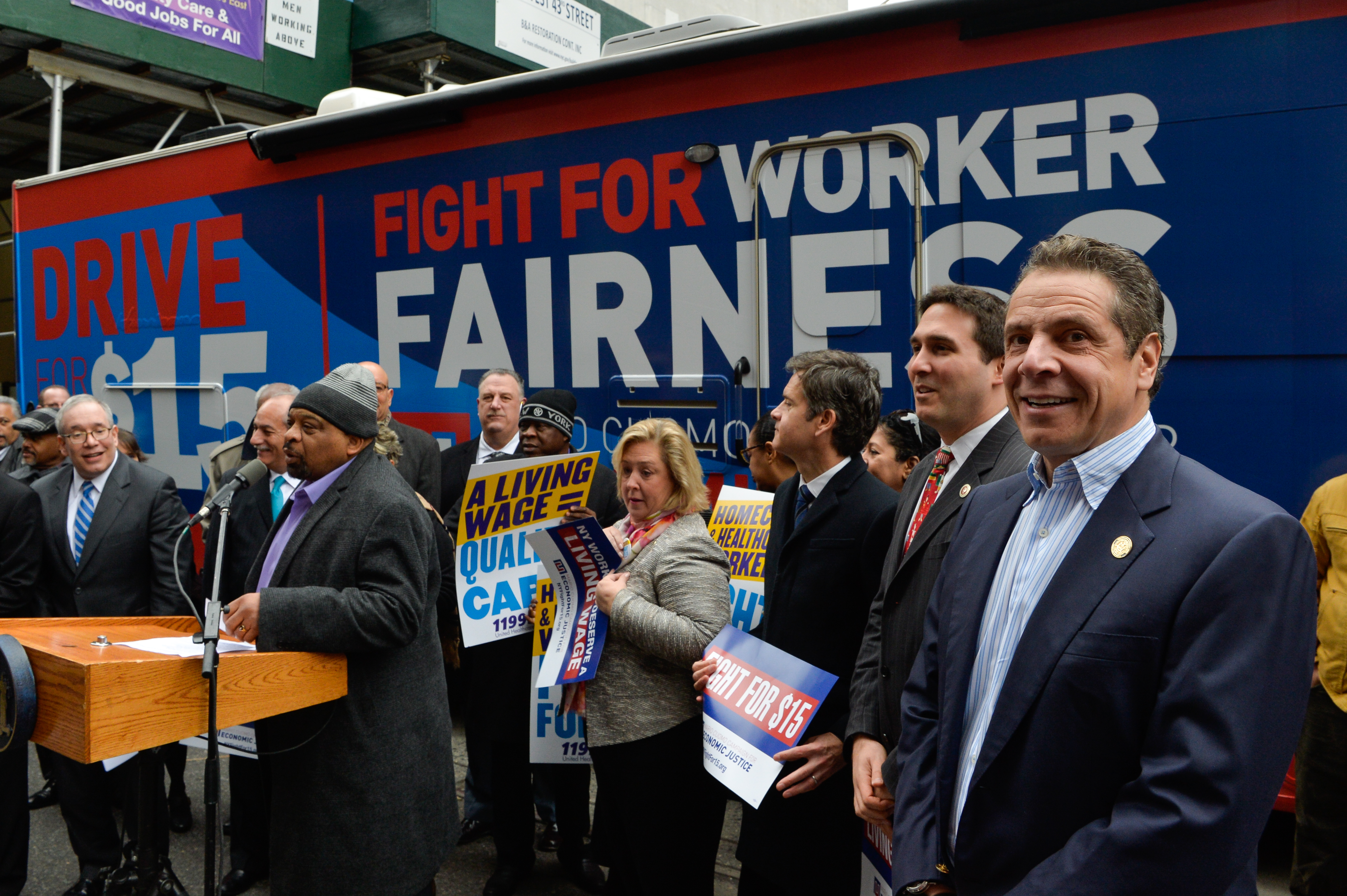 """In 2016, Gov. Andrew Cuomo helped the """"Drive for $15"""" campaign to raise the minimum wage, kick off a bus tour."""