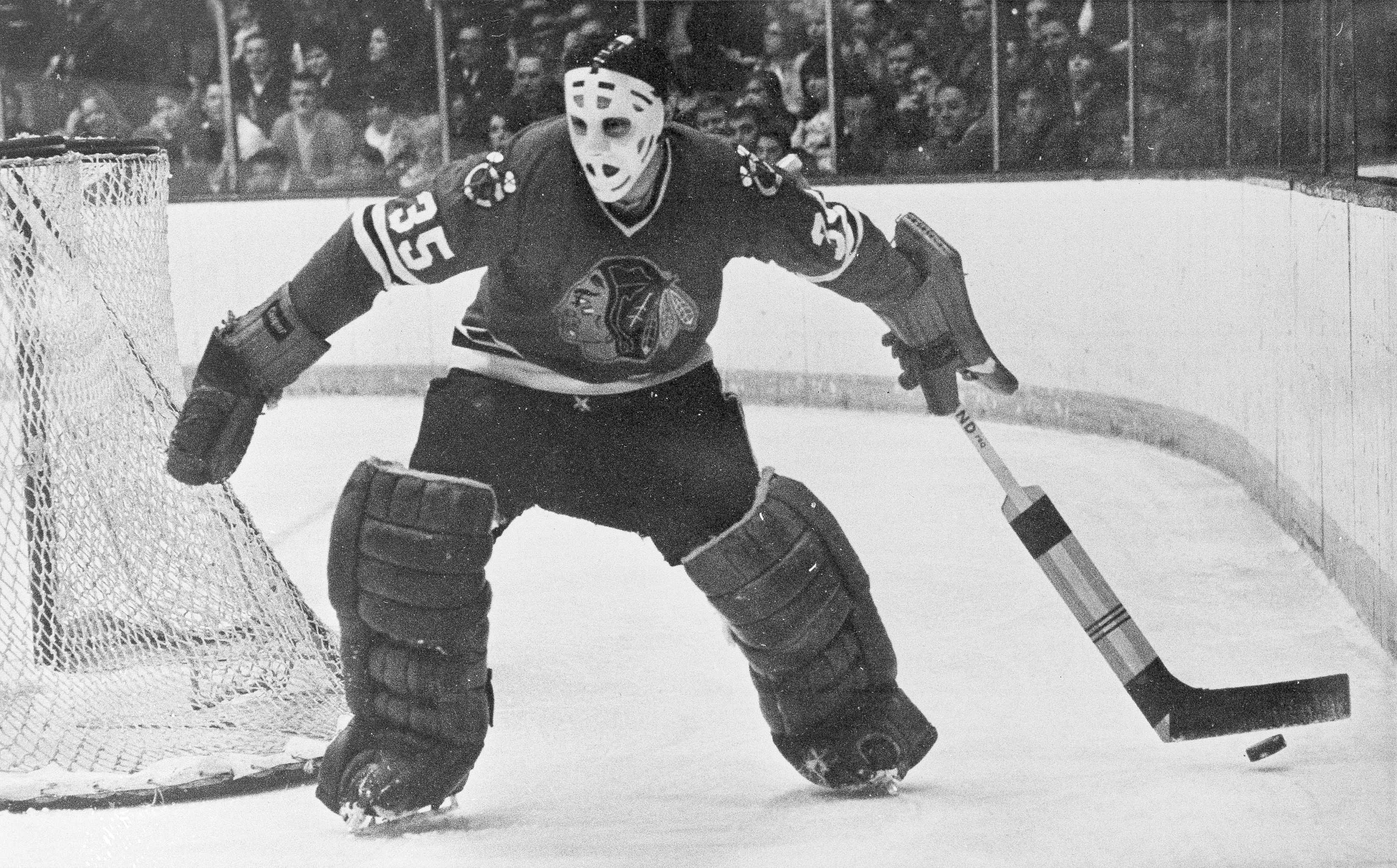 Blackhawks goalie Tony Esposito moves behind the net to stop the puck for a teammate during a 1970 game against the Toronto Maple Leafs in Chicago.