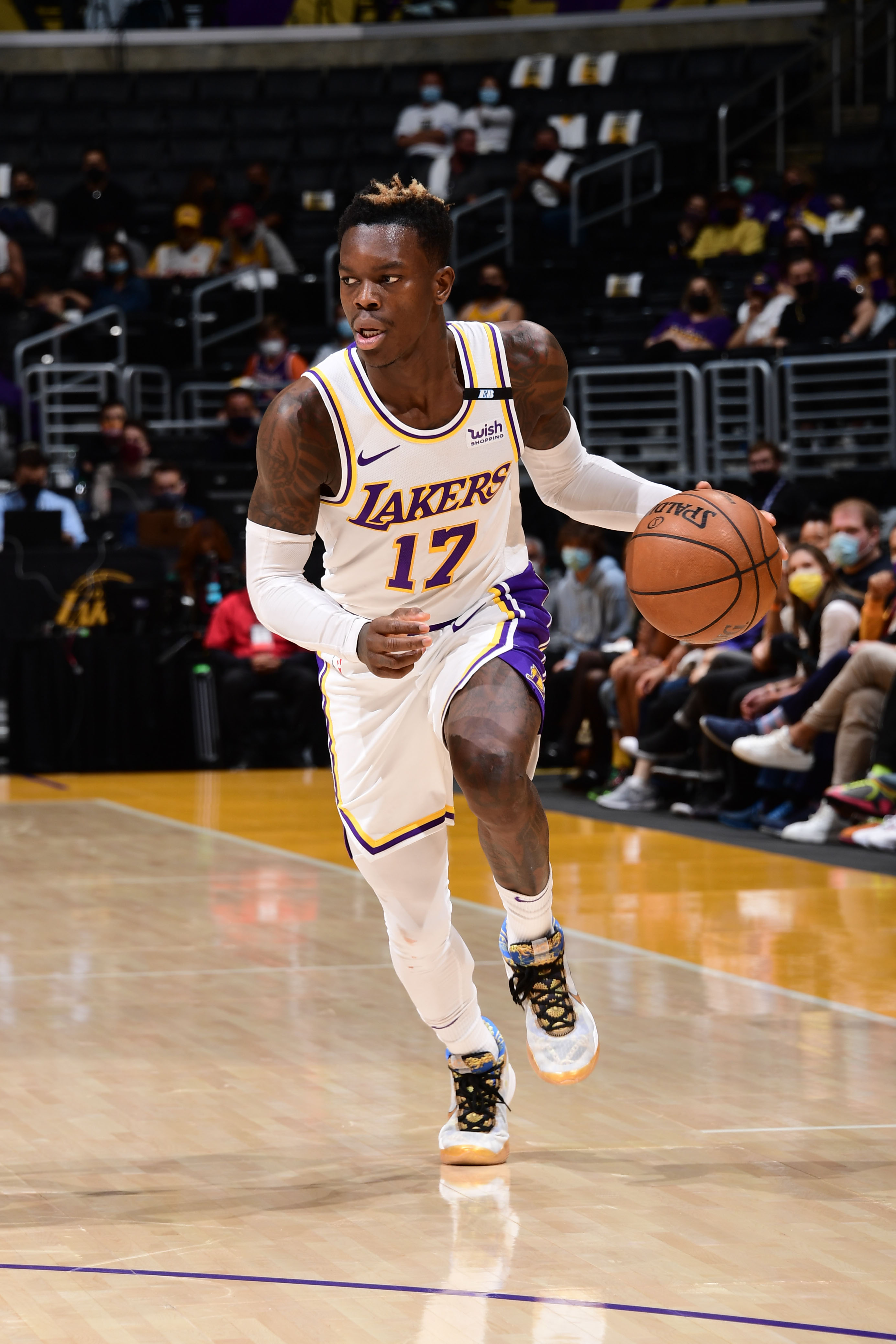Dennis Schroder #17 of the Los Angeles Lakers dribbles the ball during the game against the Phoenix Suns during Round 1, Game 4 of the 2021 NBA Playoffs on May 30, 2021 at STAPLES Center in Los Angeles, California.