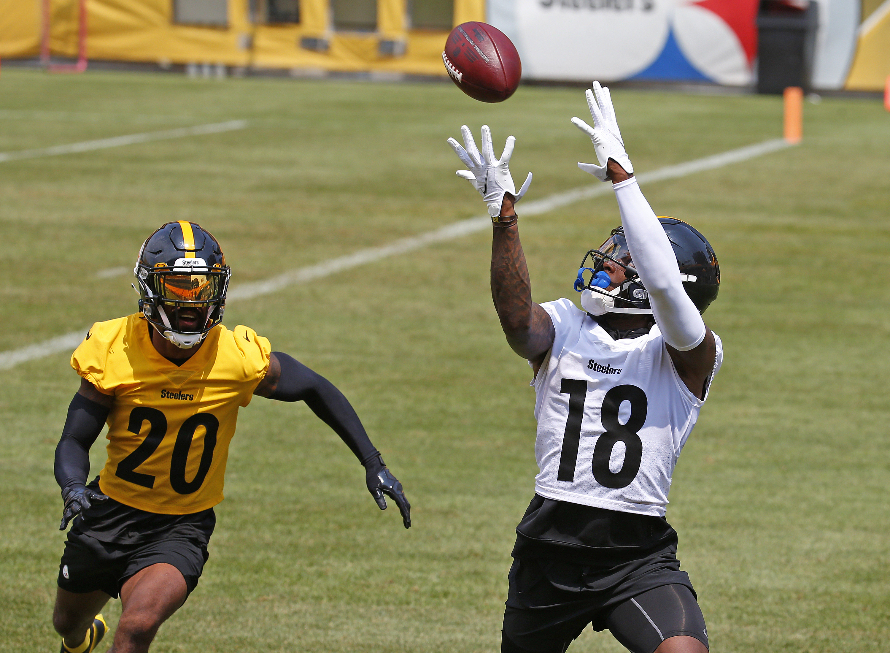 Diontae Johnson #18 of the Pittsburgh Steelers in action against Cameron Sutton #20 of the Pittsburgh Steelers during training camp at Heinz Field on July 29, 2021 in Pittsburgh, Pennsylvania.