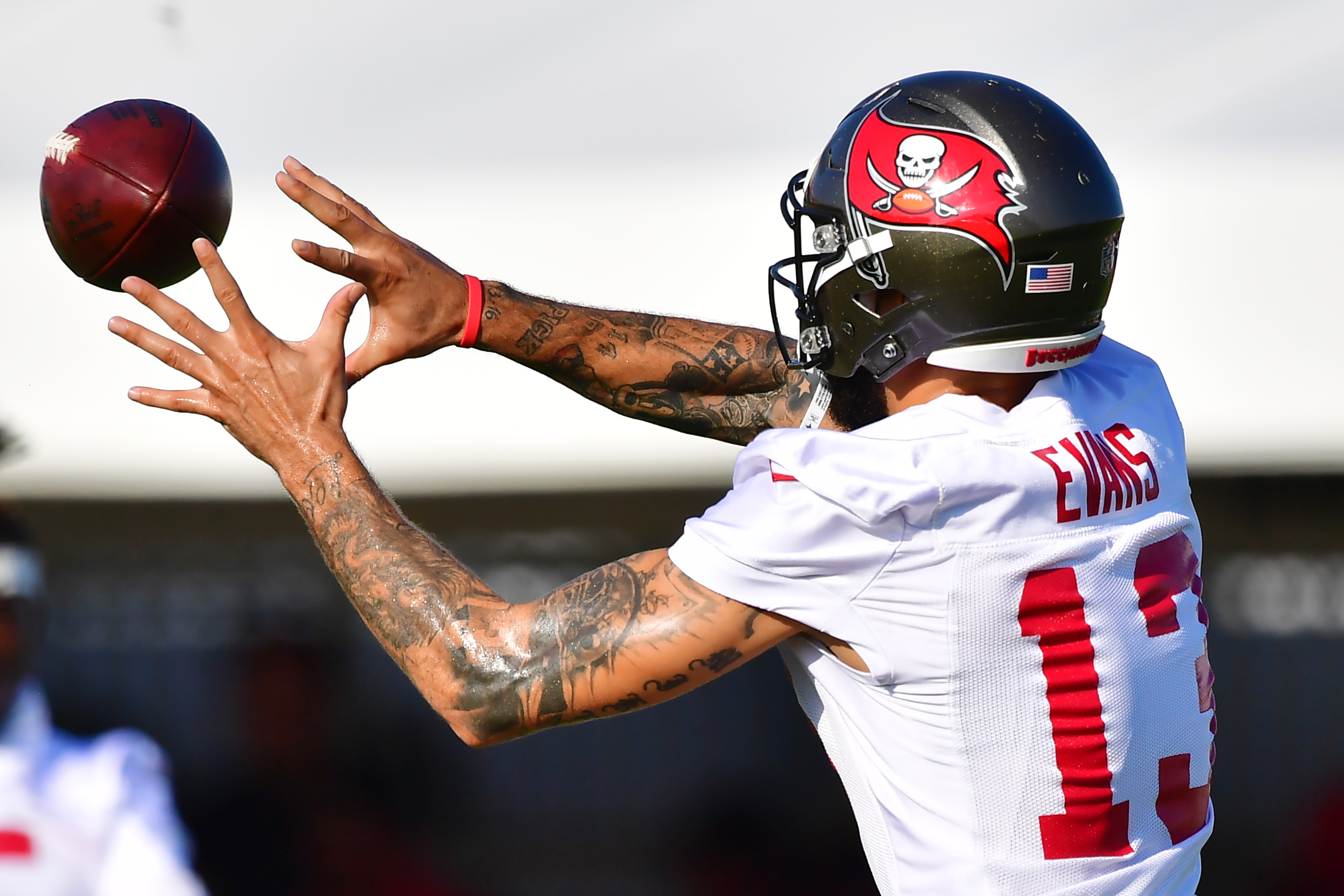 Mike Evans #13 of the Tampa Bay Buccaneers looks to catch a pass during training camp at AdventHealth Training Center on July 26, 2021 in Tampa, Florida.