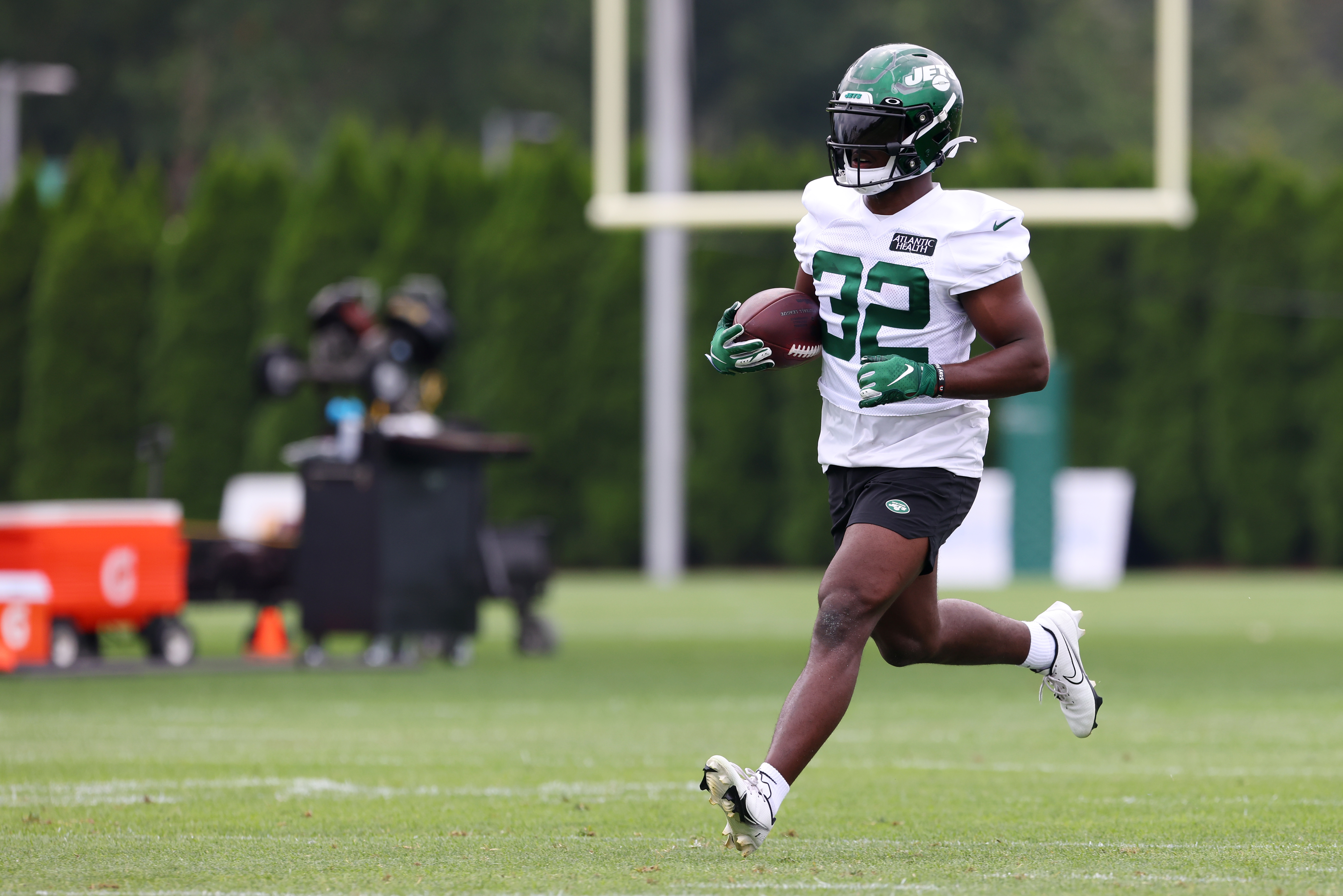 Michael Carter #32 of the New York Jets works out during a morning practice at Atlantic Health Jets Training Center on July 29, 2021 in Florham Park, New Jersey.