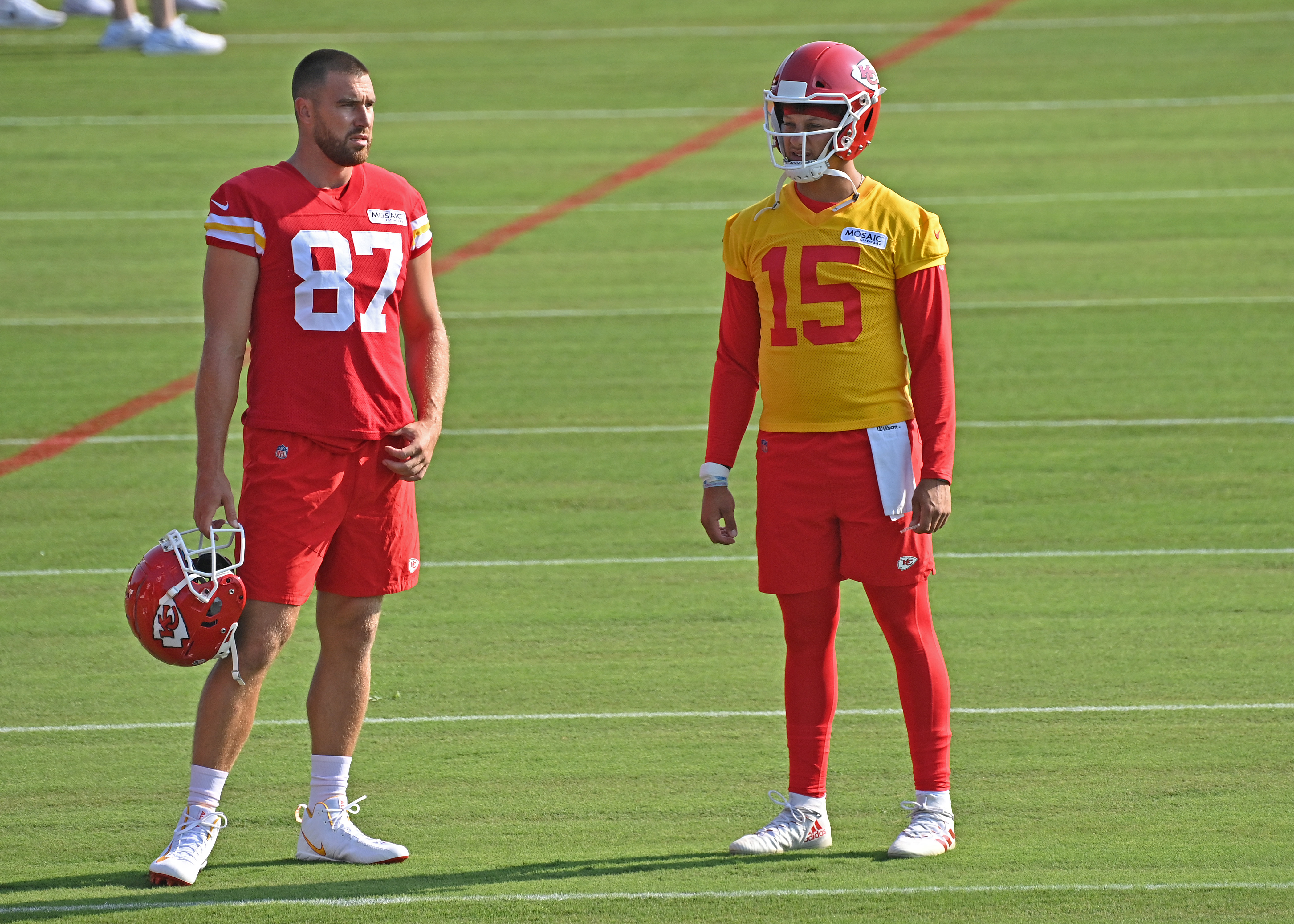 Quarterback Patrick Mahomes #15 and tight end Travis Kelce #87 of the Kansas City Chiefs talk during training camp at Missouri Western State University on July 28, 2021 in St Joseph, Missouri.
