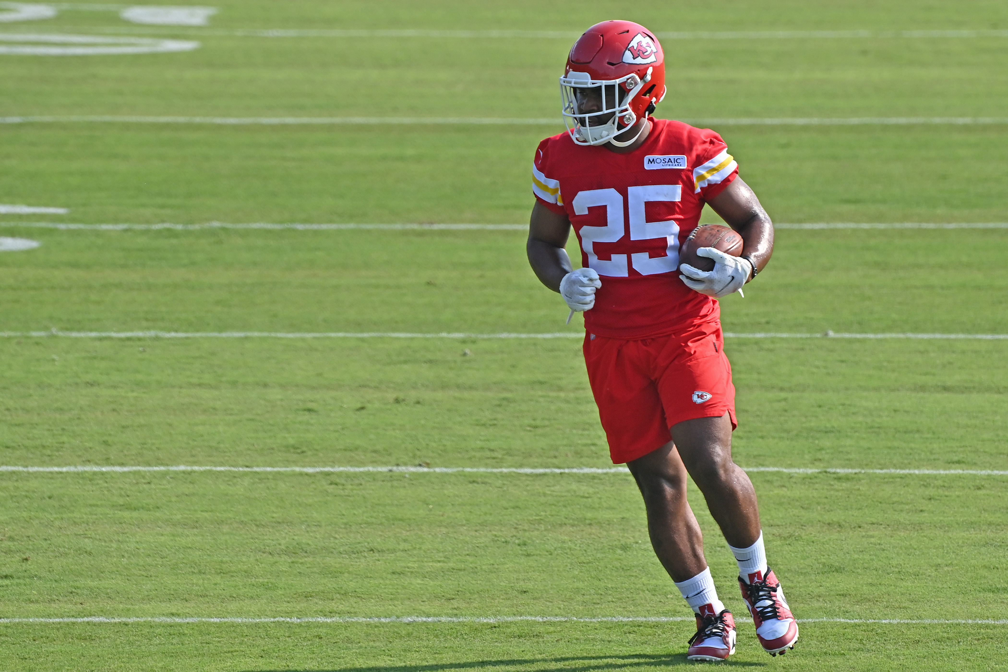 Running back Clyde Edwards-Helaire #25 of the Kansas City Chiefs runs drills during training camp at Missouri Western State University on July 28, 2021 in St Joseph, Missouri.