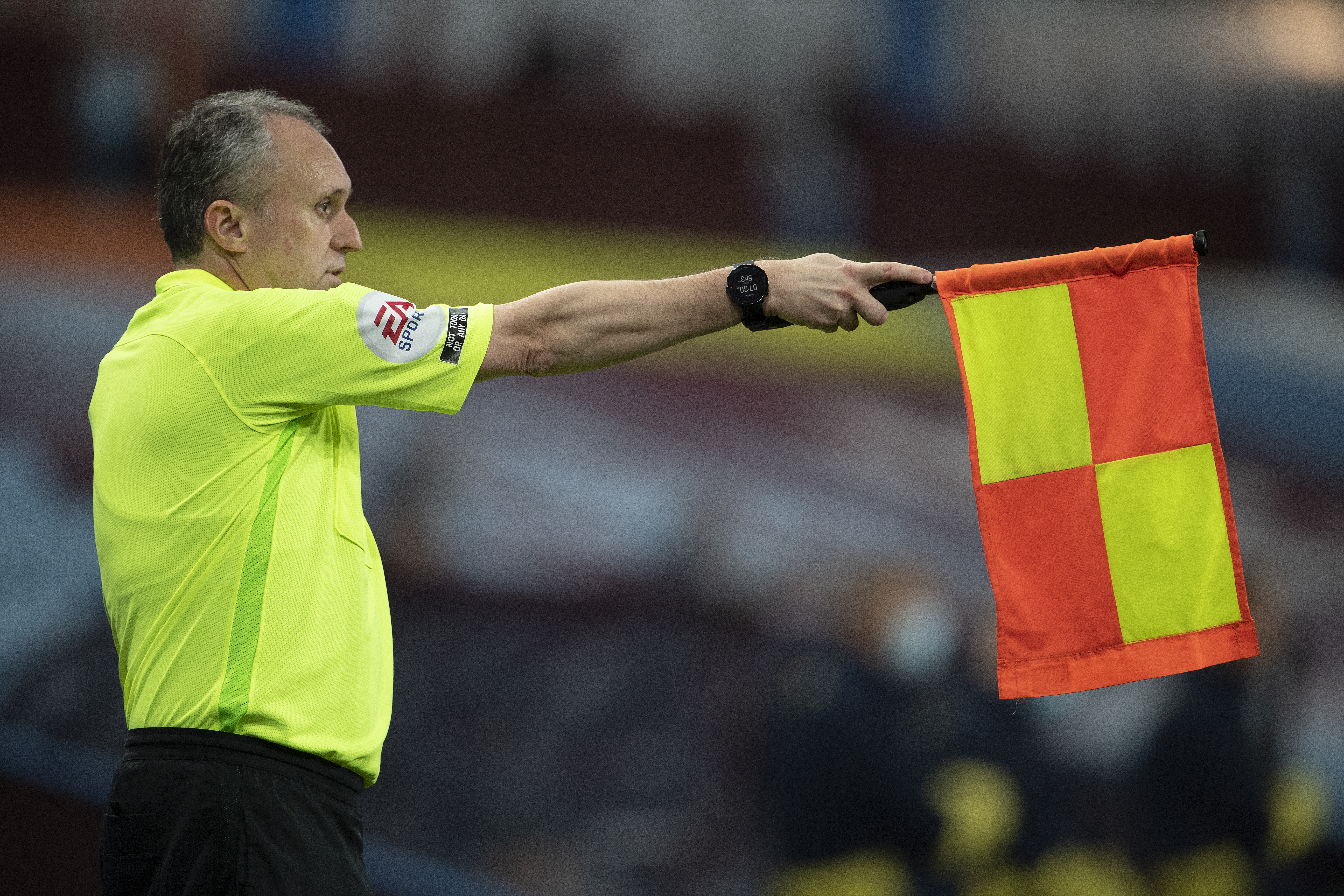 Assistant referee raises his flag for an offside during the Carabao Cup fourth round match between Aston Villa and Stoke City at Villa Park on October 01, 2020 in Birmingham, England