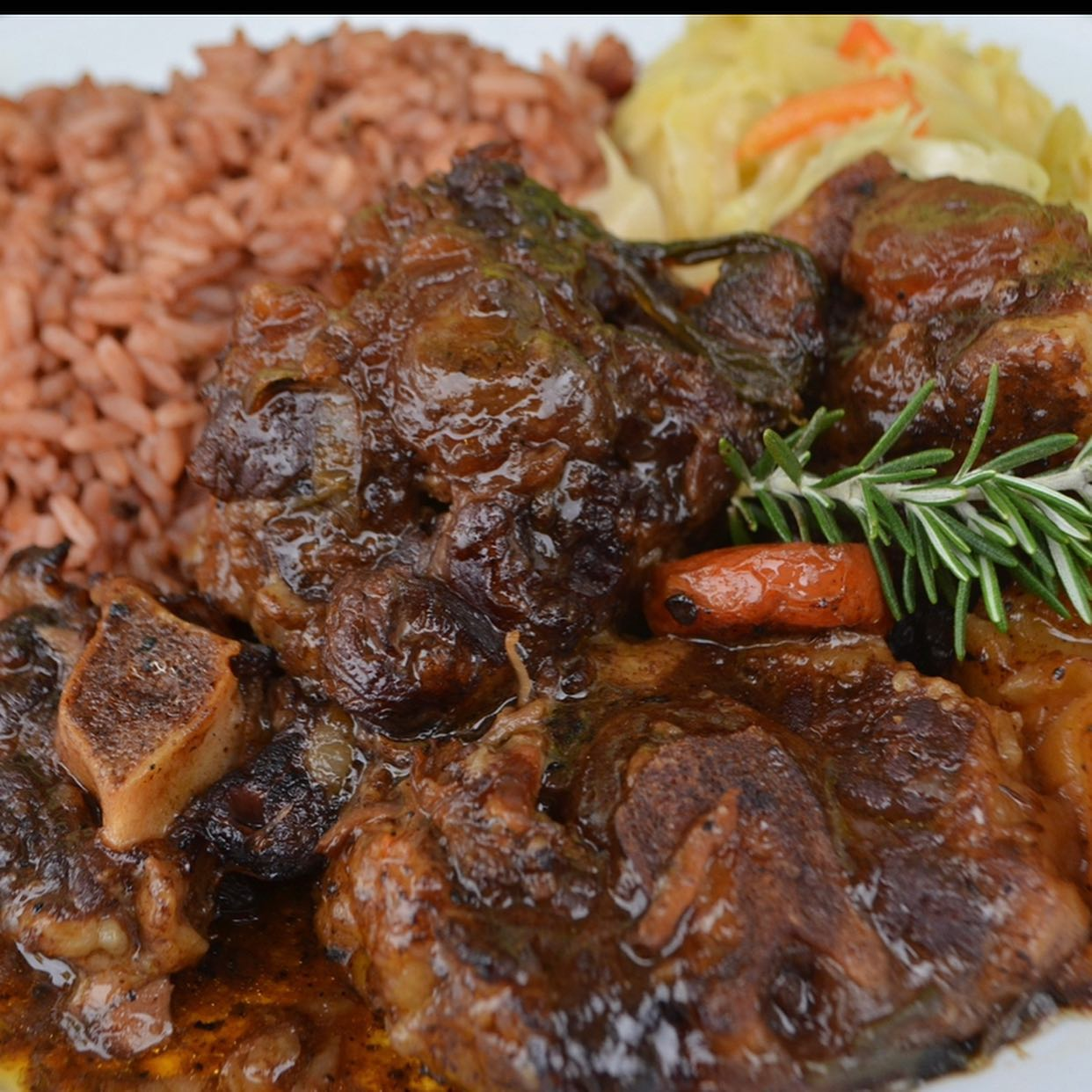 a spread of braised oxtails and peas and rice