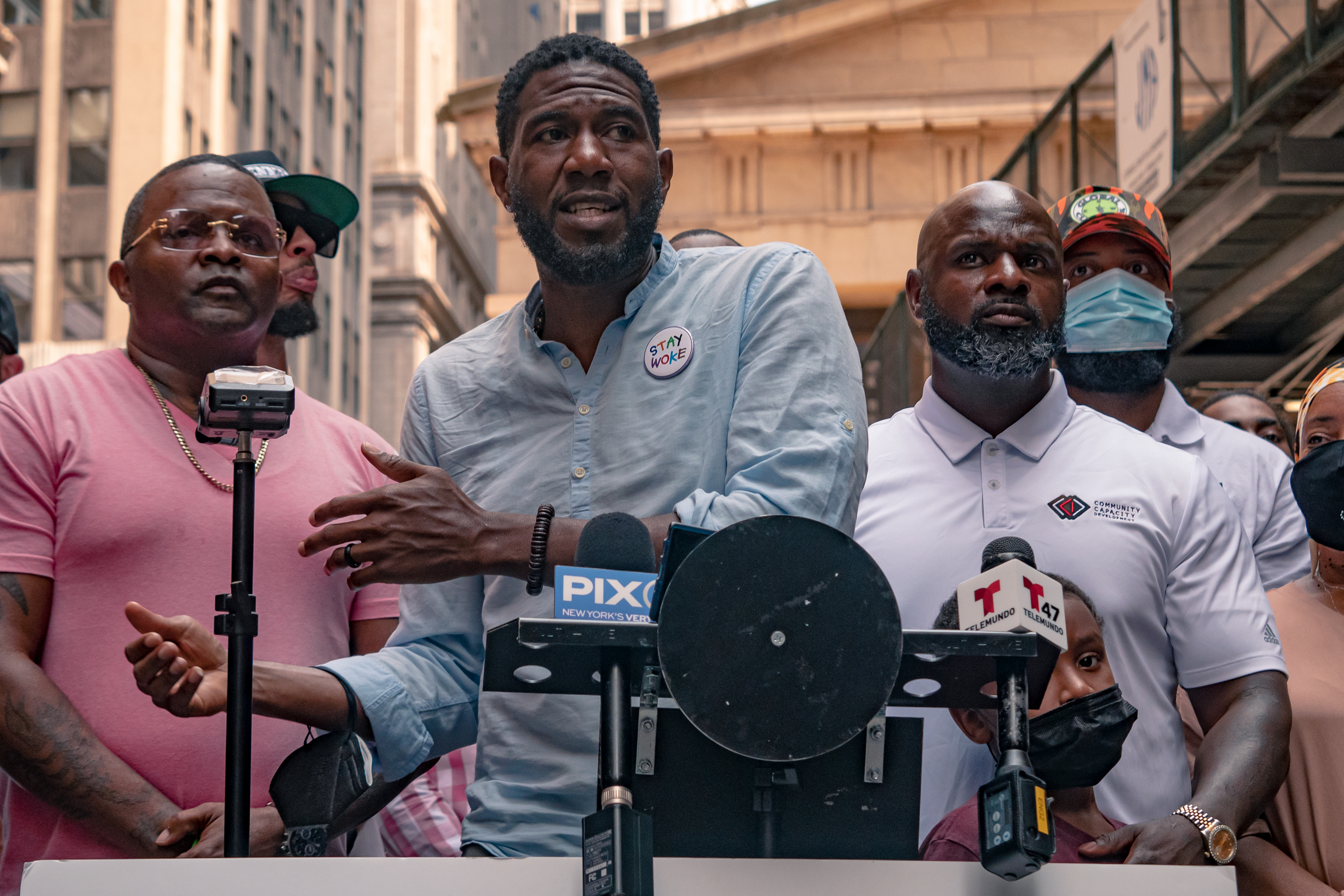 Public Advocate Jumanne Williams speaks at a Wall Street anti-violence protest organized by K. Bain, founder of Community Capacity Development (right) on Aug. 10, 2021.