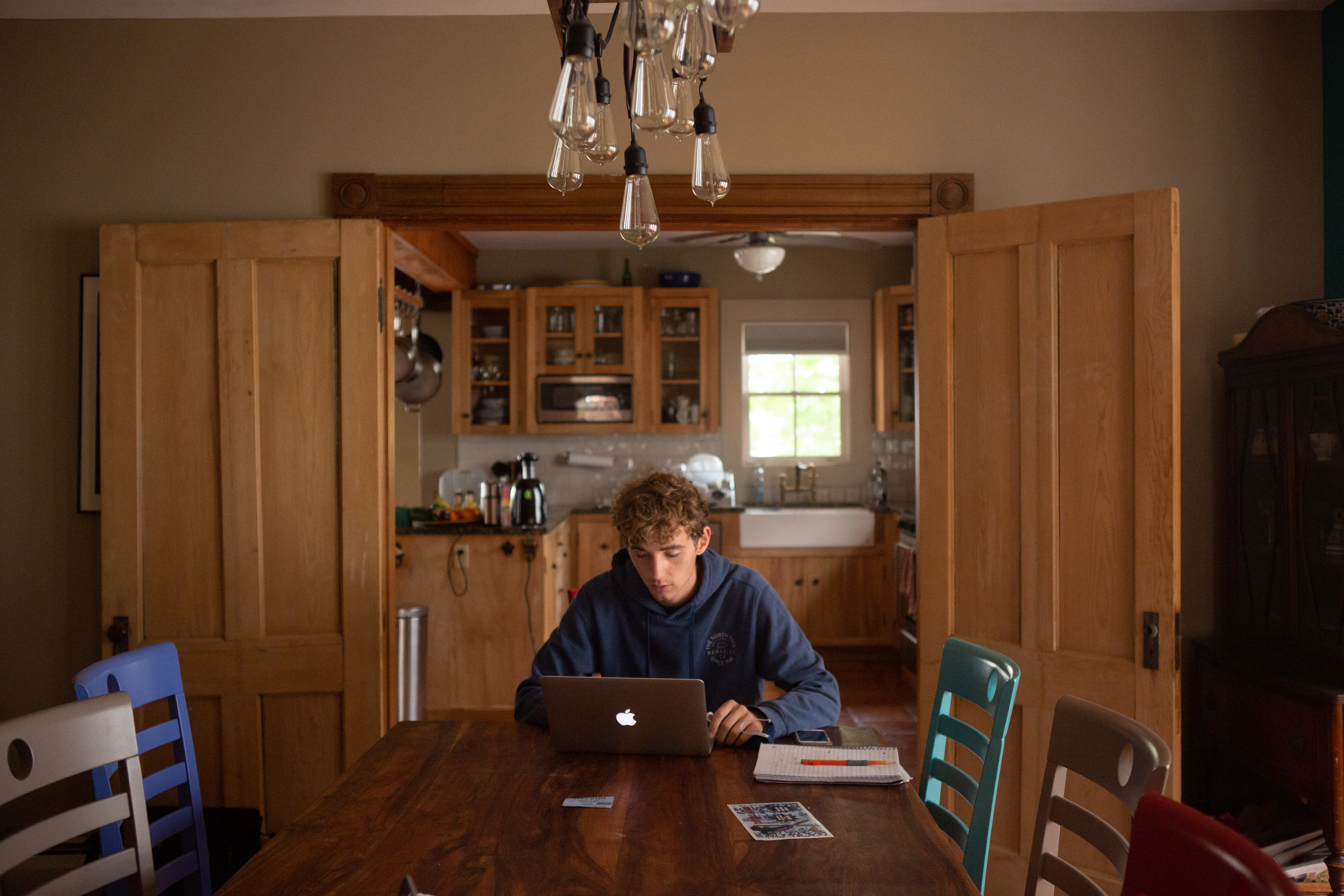 Twins and high school seniors Dermot and Aidan McMillan do classwork from their home.