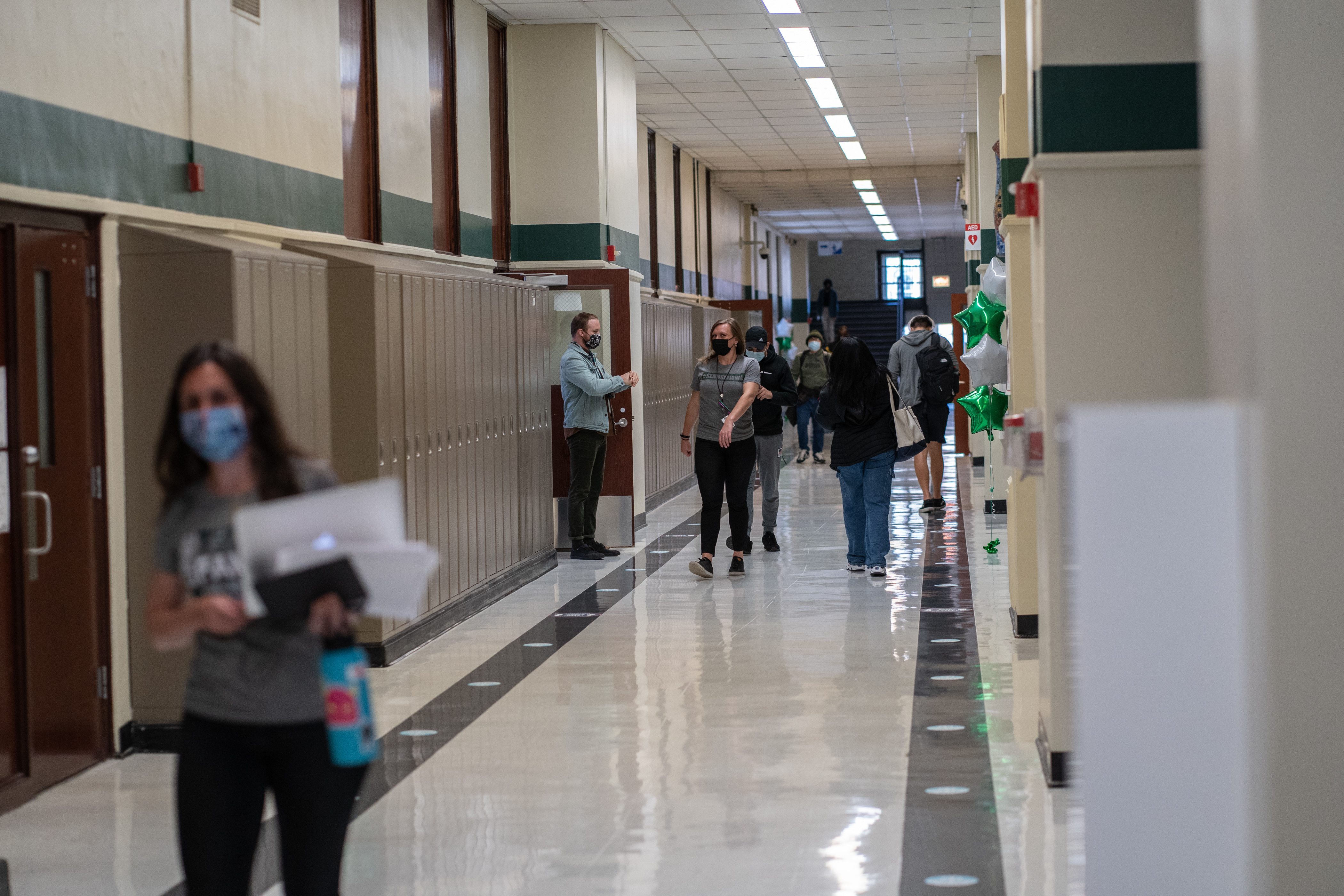 Staff and students walk the halls of Senn High School on the first week back to classrooms on April 23, 2021.