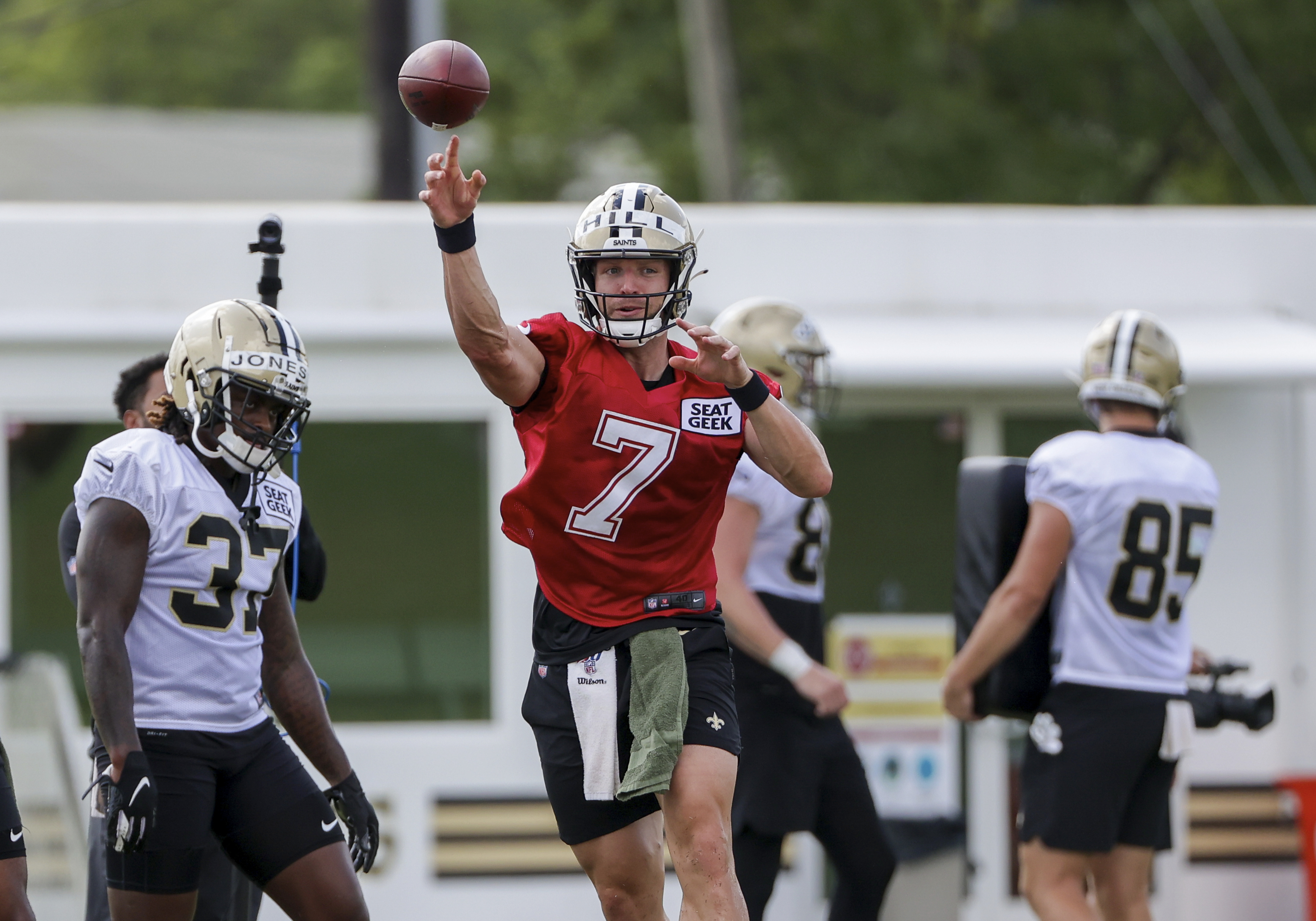 New Orleans Saints quarterback Taysom Hill throws a pass during NFL football training camp.