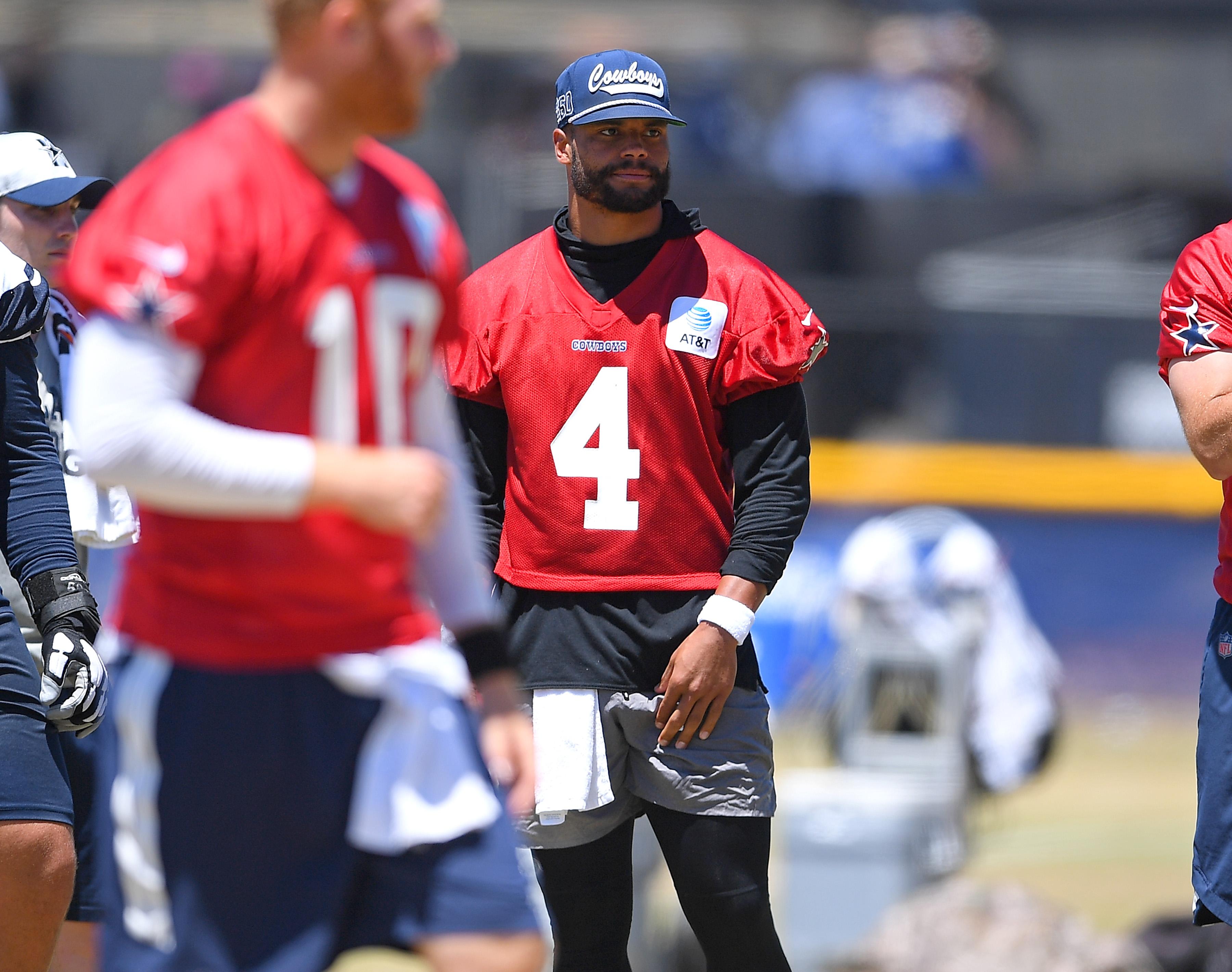 Quarterback Dak Prescott #4 of the Dallas Cowboys looks on during training camp at River Ridge Complex on August 3, 2021 in Oxnard, California.