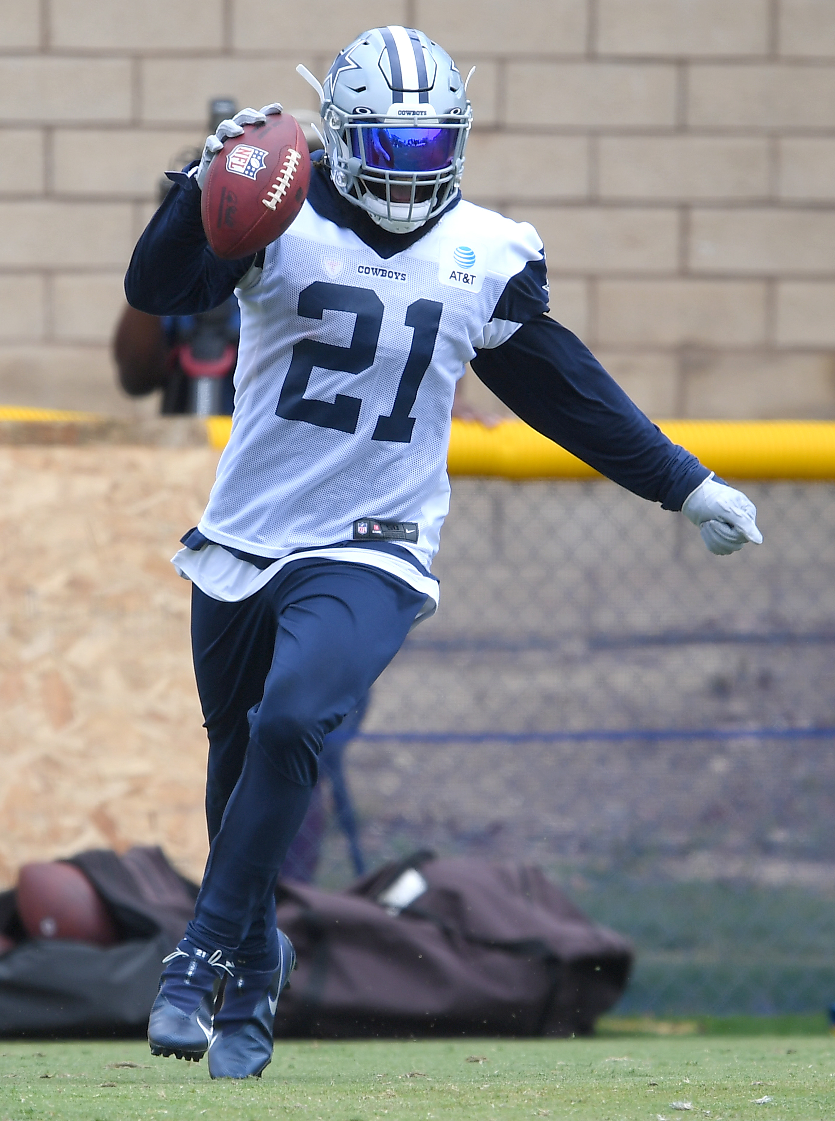 Running back Ezekiel Elliott #21 of the Dallas Cowboys catches a pass during training camp at River Ridge Complex on July 24, 2021 in Oxnard, California.