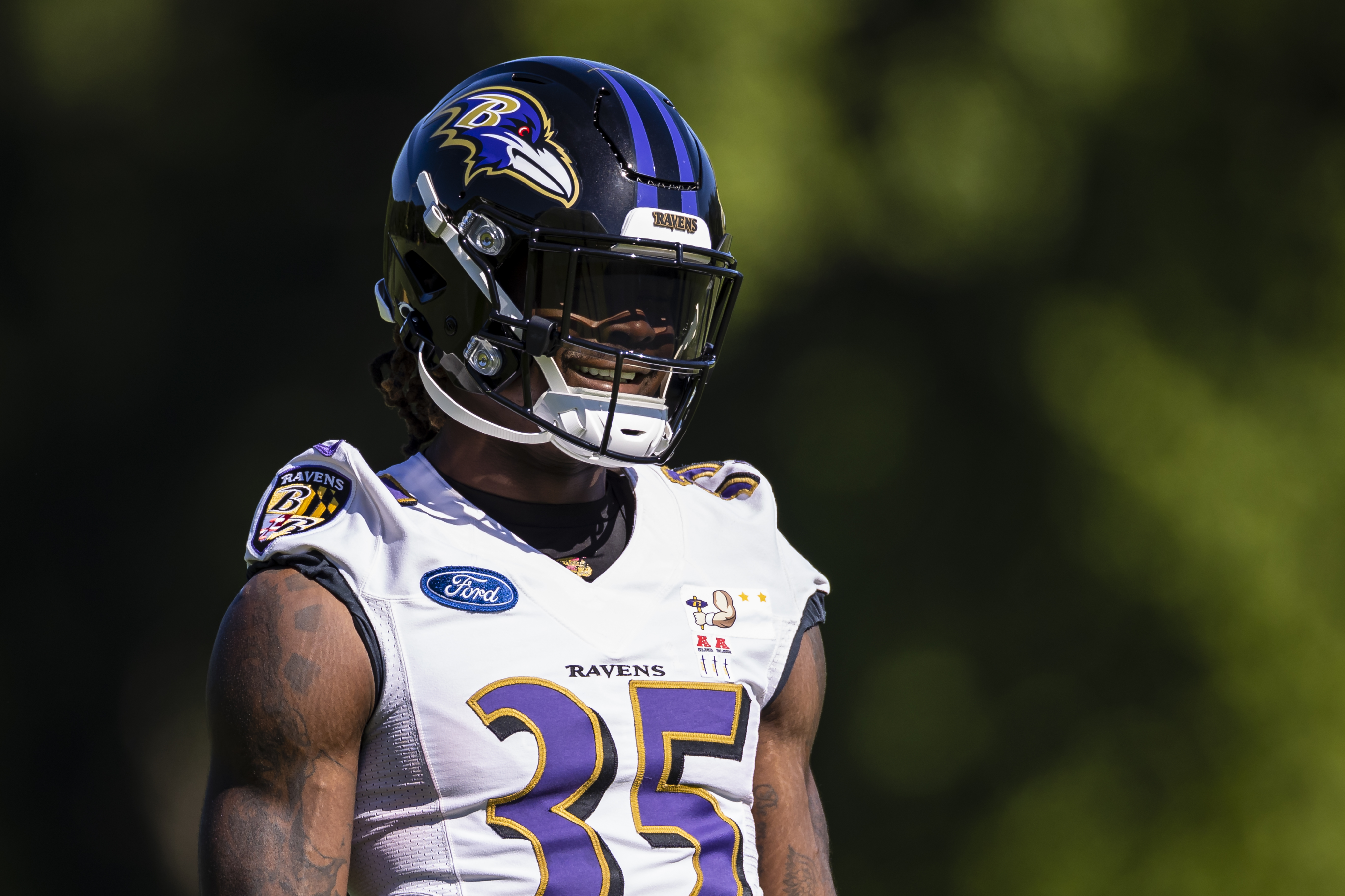 Gus Edwards #35 of the Baltimore Ravens works out during mandatory minicamp at Under Armour Performance Center on June 16, 2021 in Owings Mills, Maryland.