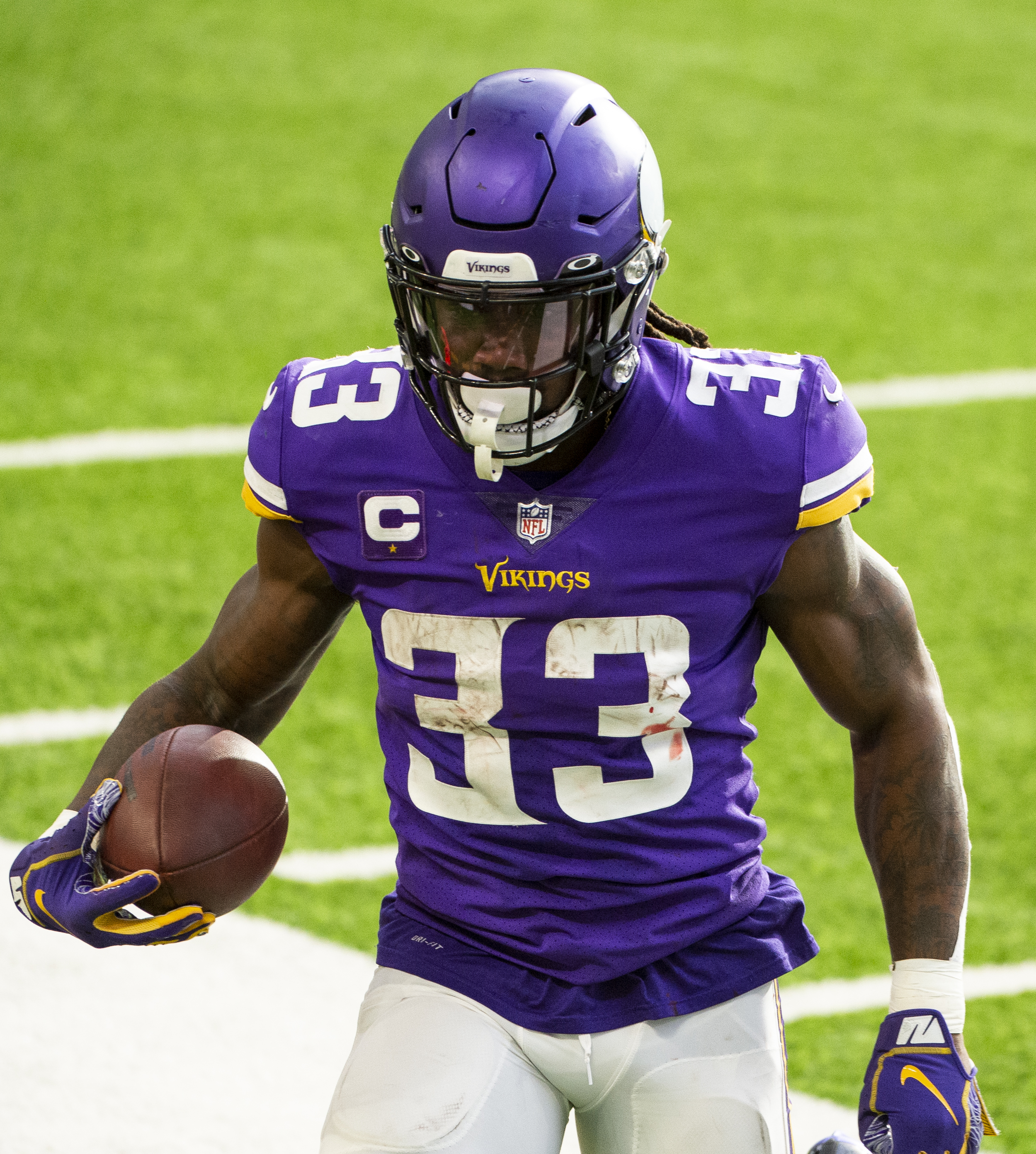 Dalvin Cook #33 of the Minnesota Vikings runs with the ball in the second quarter of the game against the Chicago Bears at U.S. Bank Stadium on December 20, 2020 in Minneapolis, Minnesota.