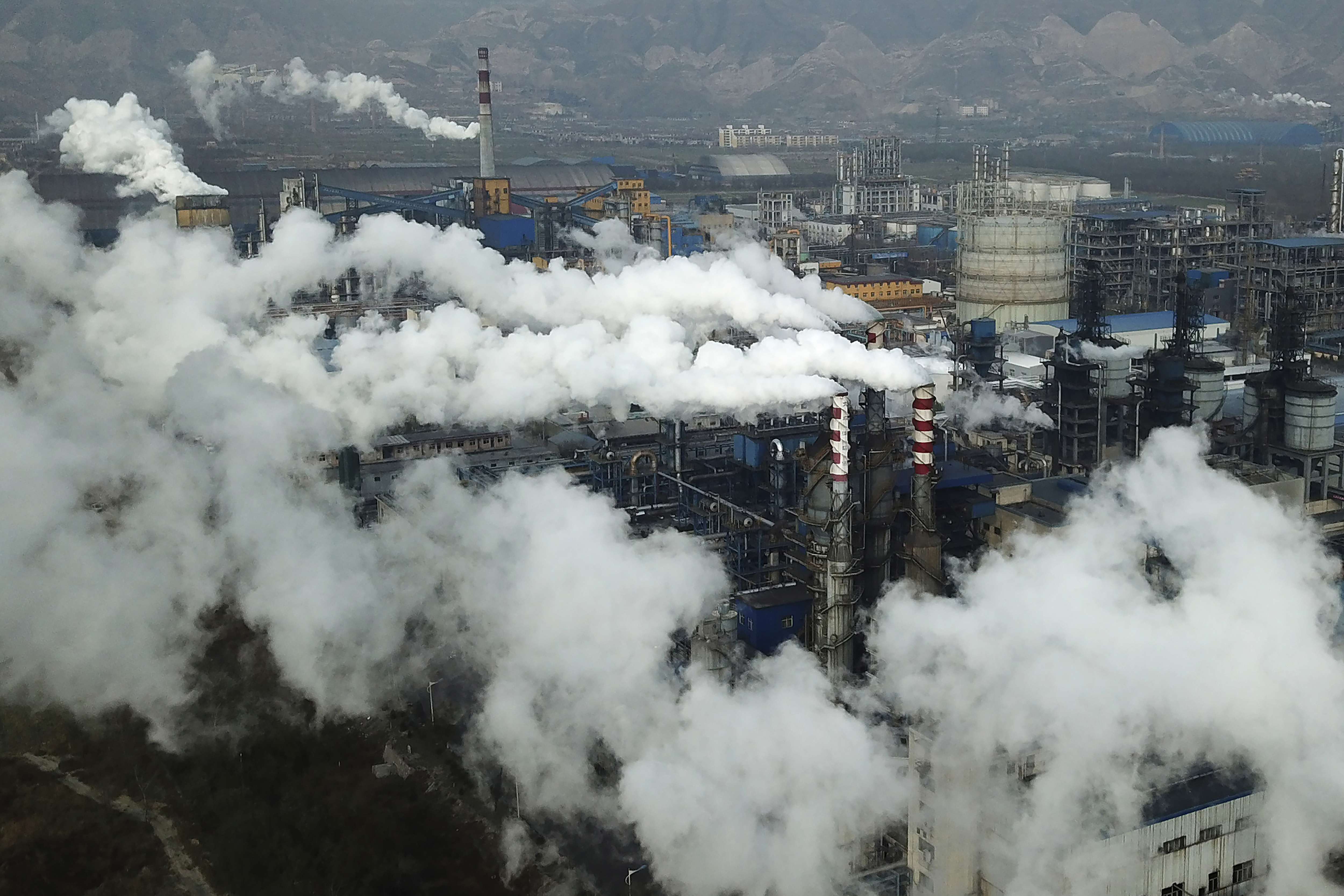Smoke and steam rise from a coal processing plant in China.
