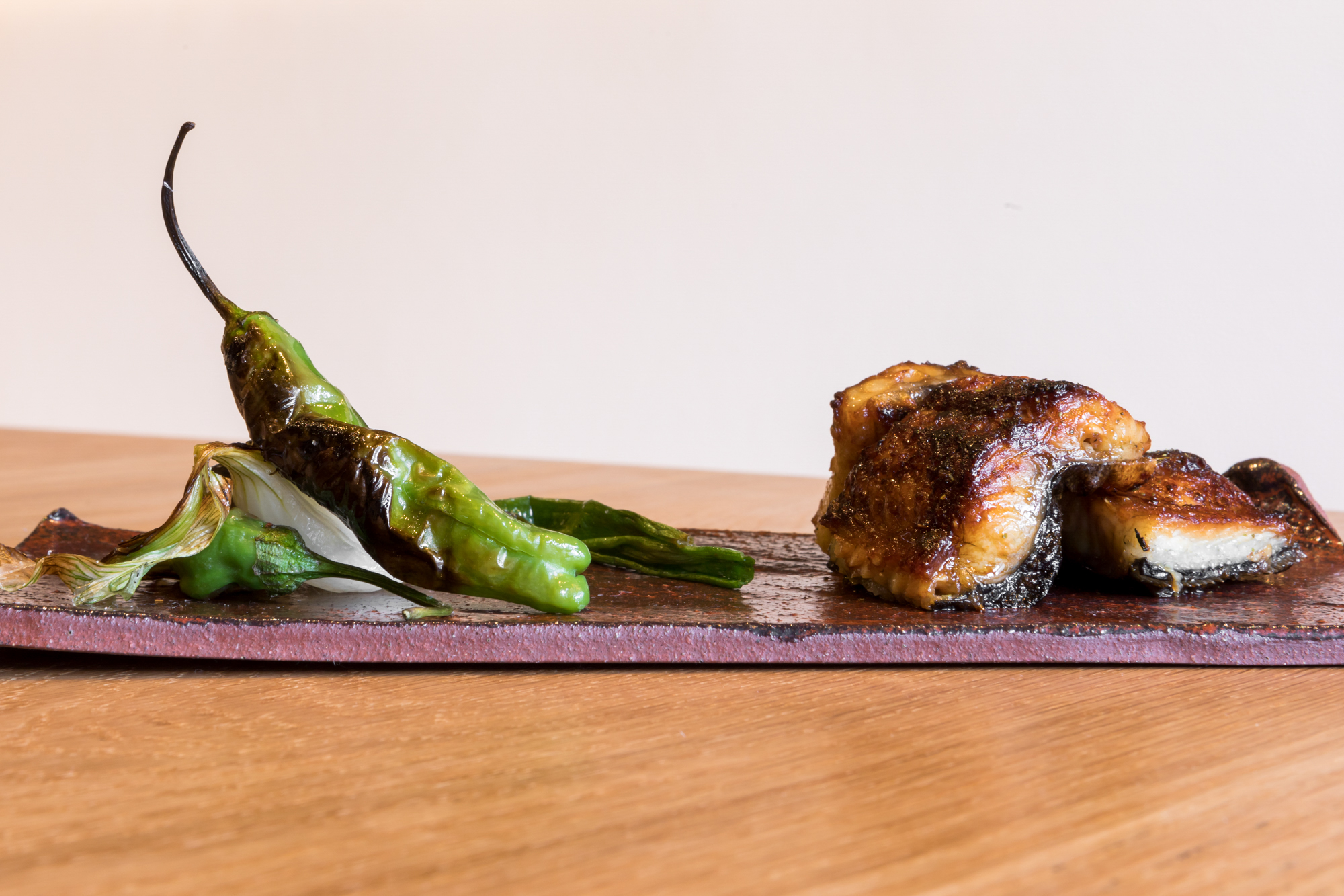 Grilled unagi and shishito peppers