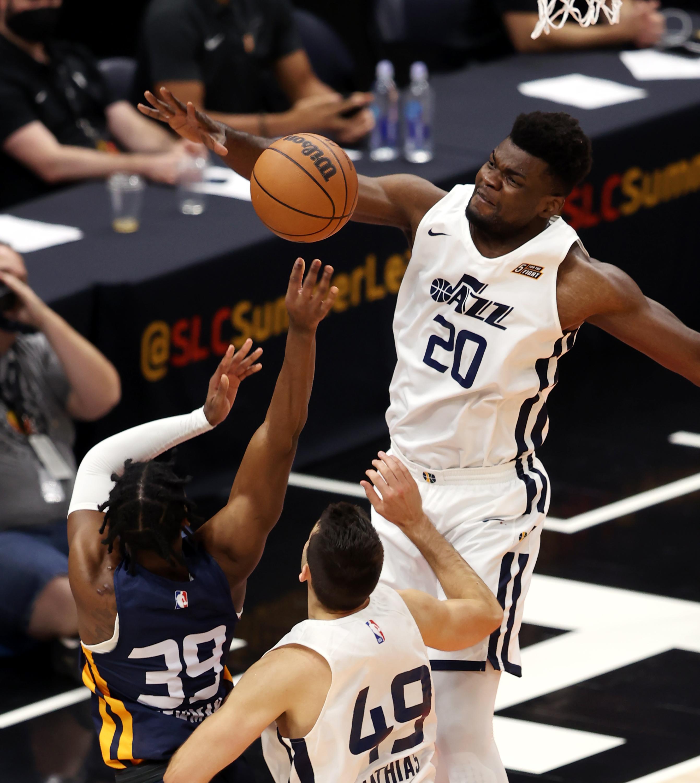 Utah Jazz White team center Udoka Azubuike (20) blocks Utah Jazz Blue team guard Malik Newman.