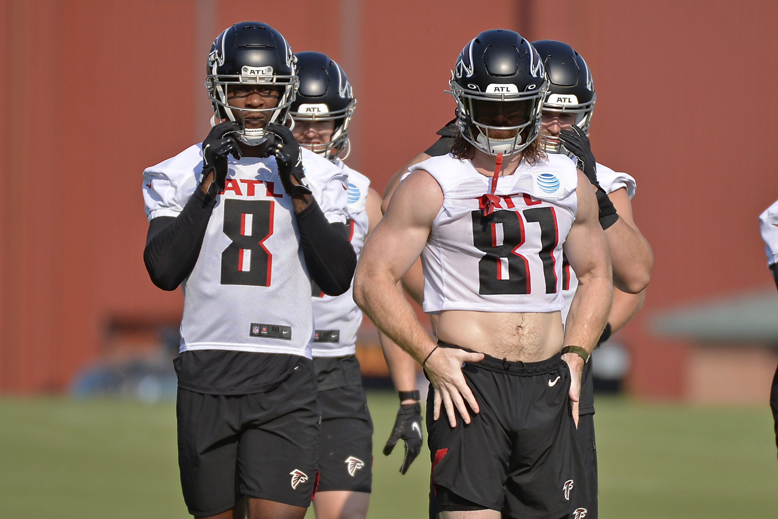 Kyle Pitts #8 and Hayden Hurst #81 of the Atlanta Falcons attend the first day of Falcons Training Camp at IBM Performance Field on July 29, 2021 in Flowery Branch, Georgia.