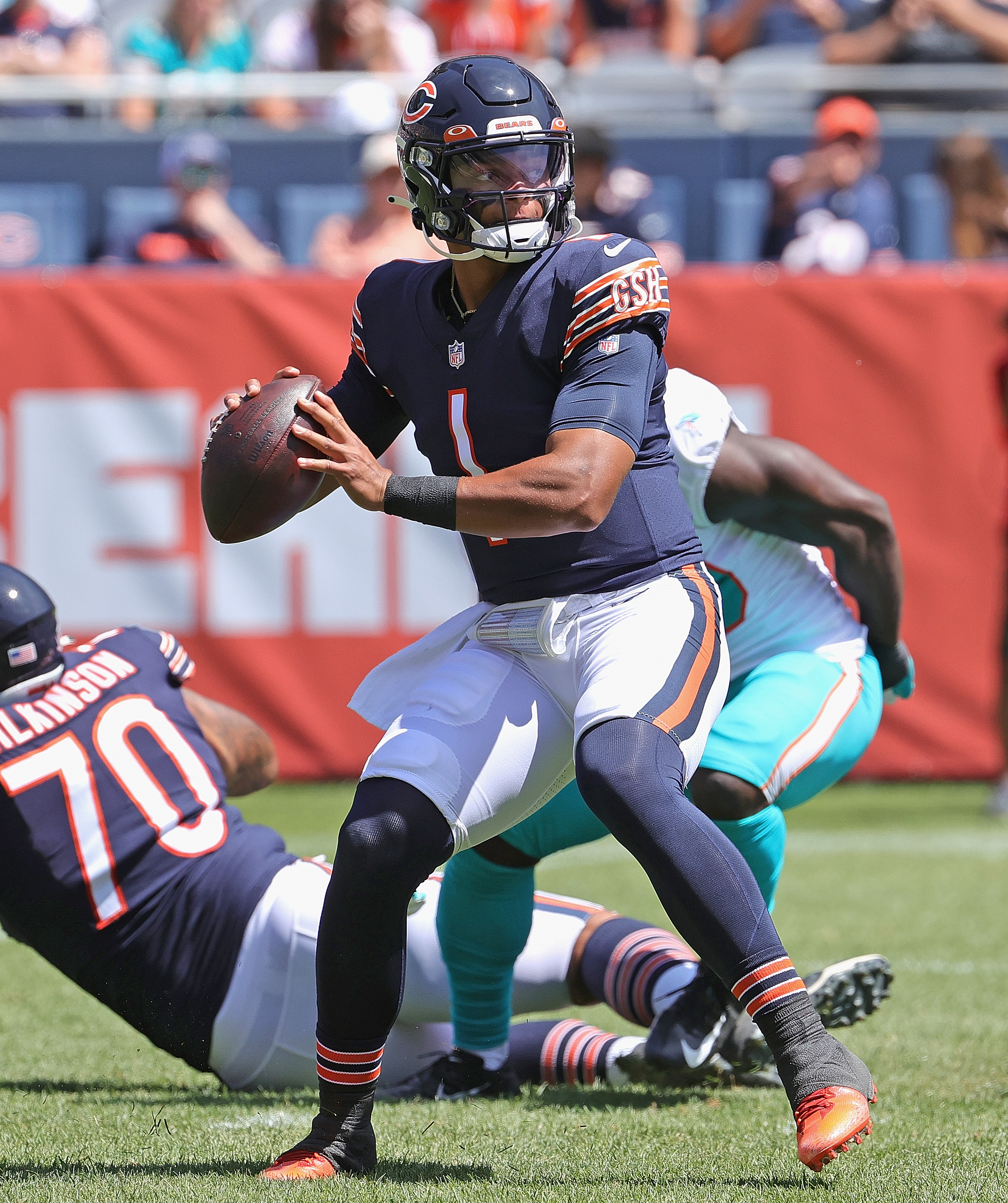 Justin Fields #1 of the Chicago Bears passes against the Miami Dolphins during a preseason game at Soldier Field on August 14, 2021 in Chicago, Illinois.