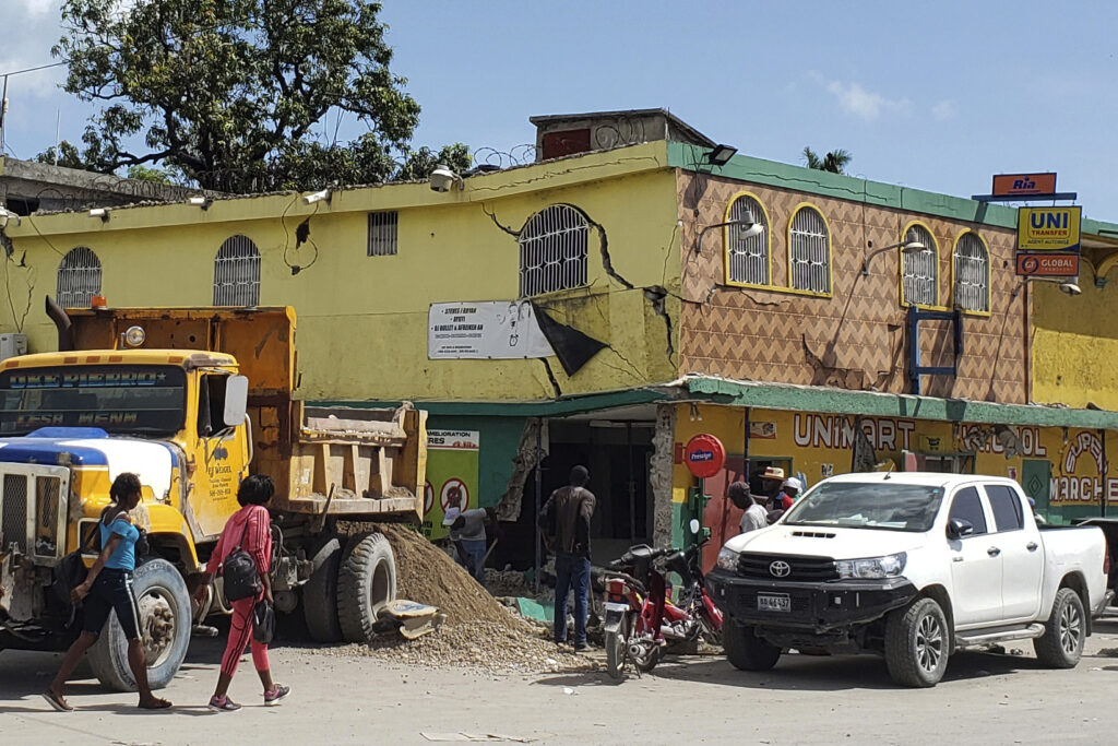 The K-oriol mini mart building is damaged after an earthquake in Les Cayes, Haiti, Saturday, Aug. 14, 2021.