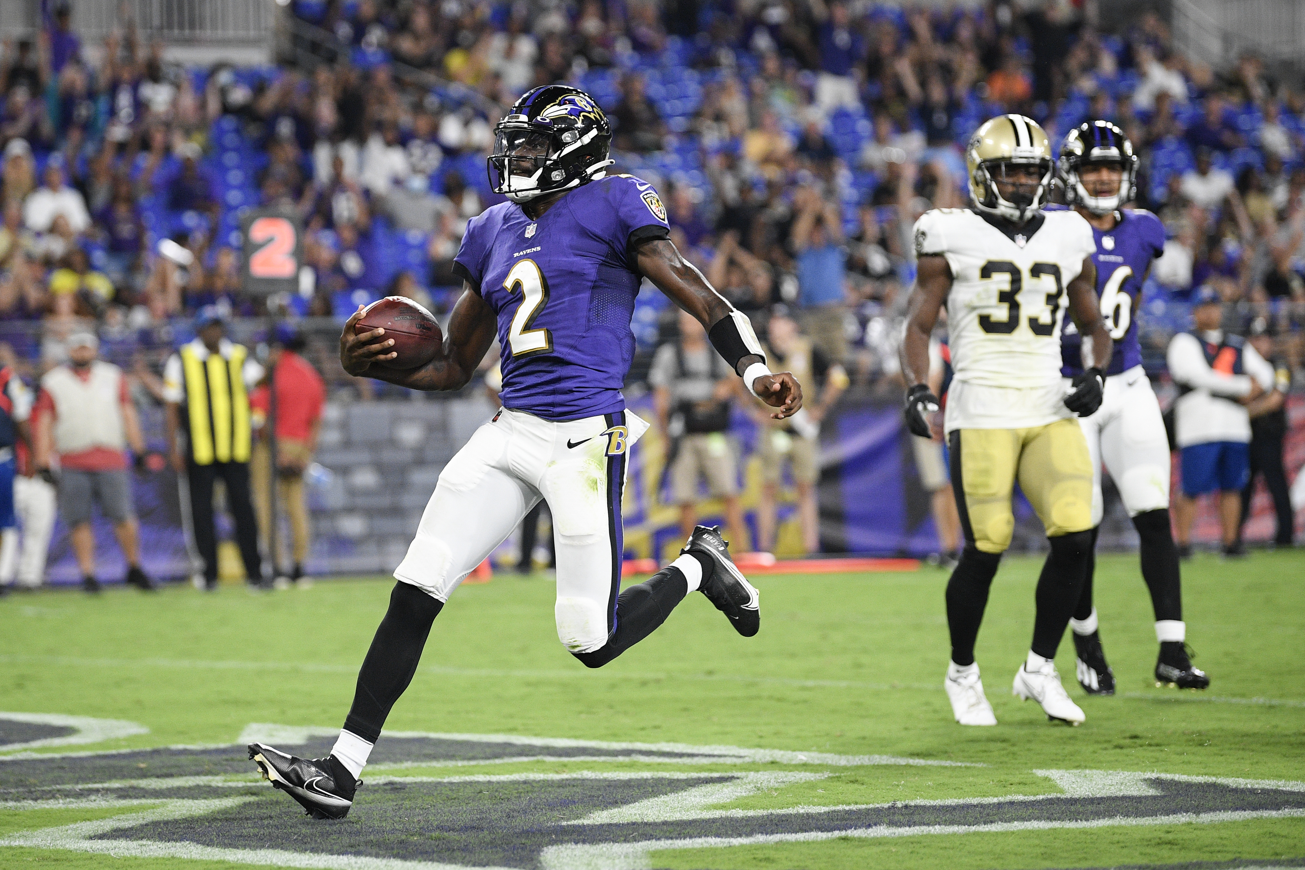 Baltimore Ravens quarterback Tyler Huntley (2) scores a touchdown on a keeper against the New Orleans Saints.
