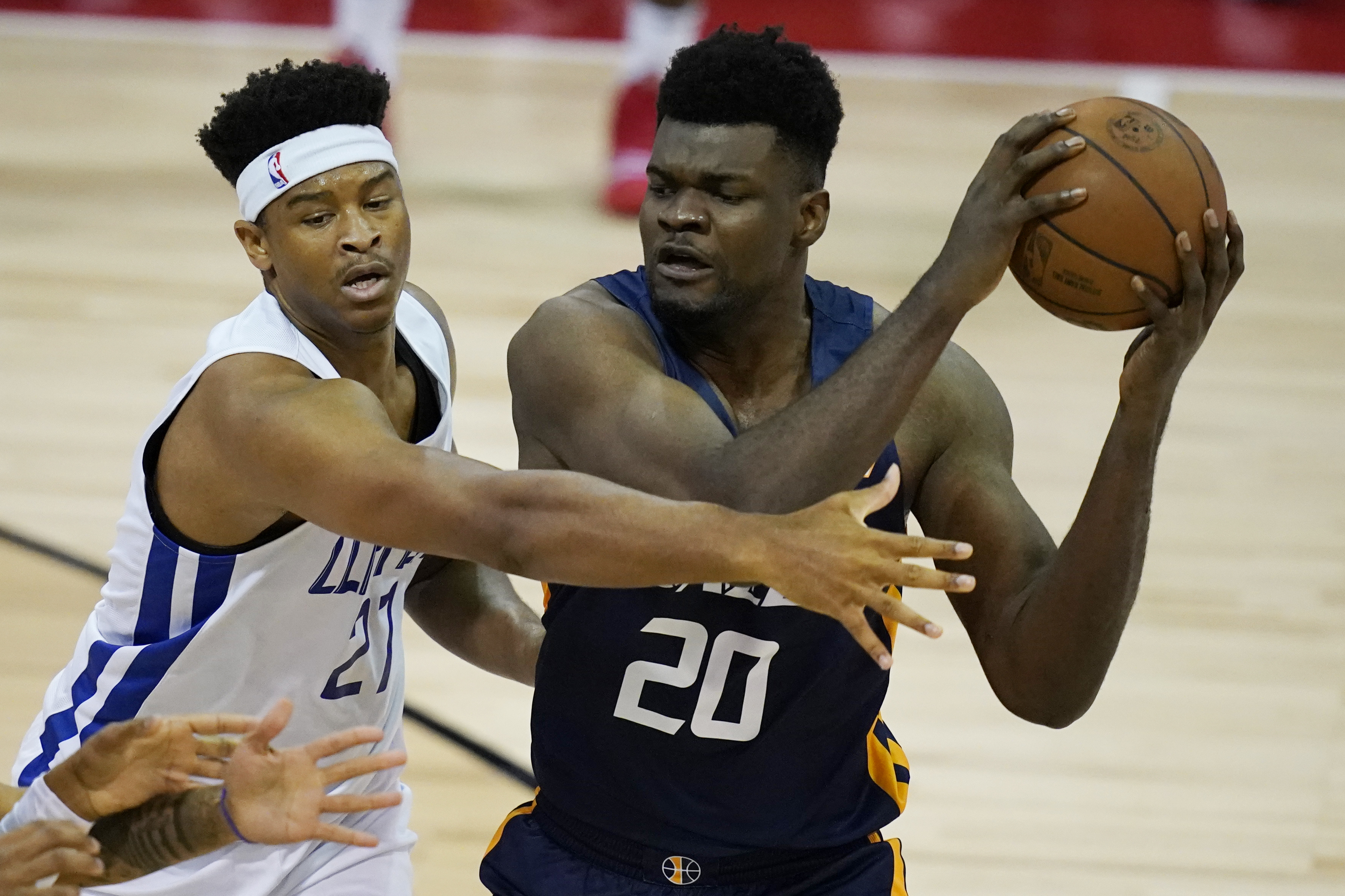 Utah Jazz's Udoka Azubuike looks to pass against Los Angeles Clippers' Isaiah Hicks during an NBA summer league game.