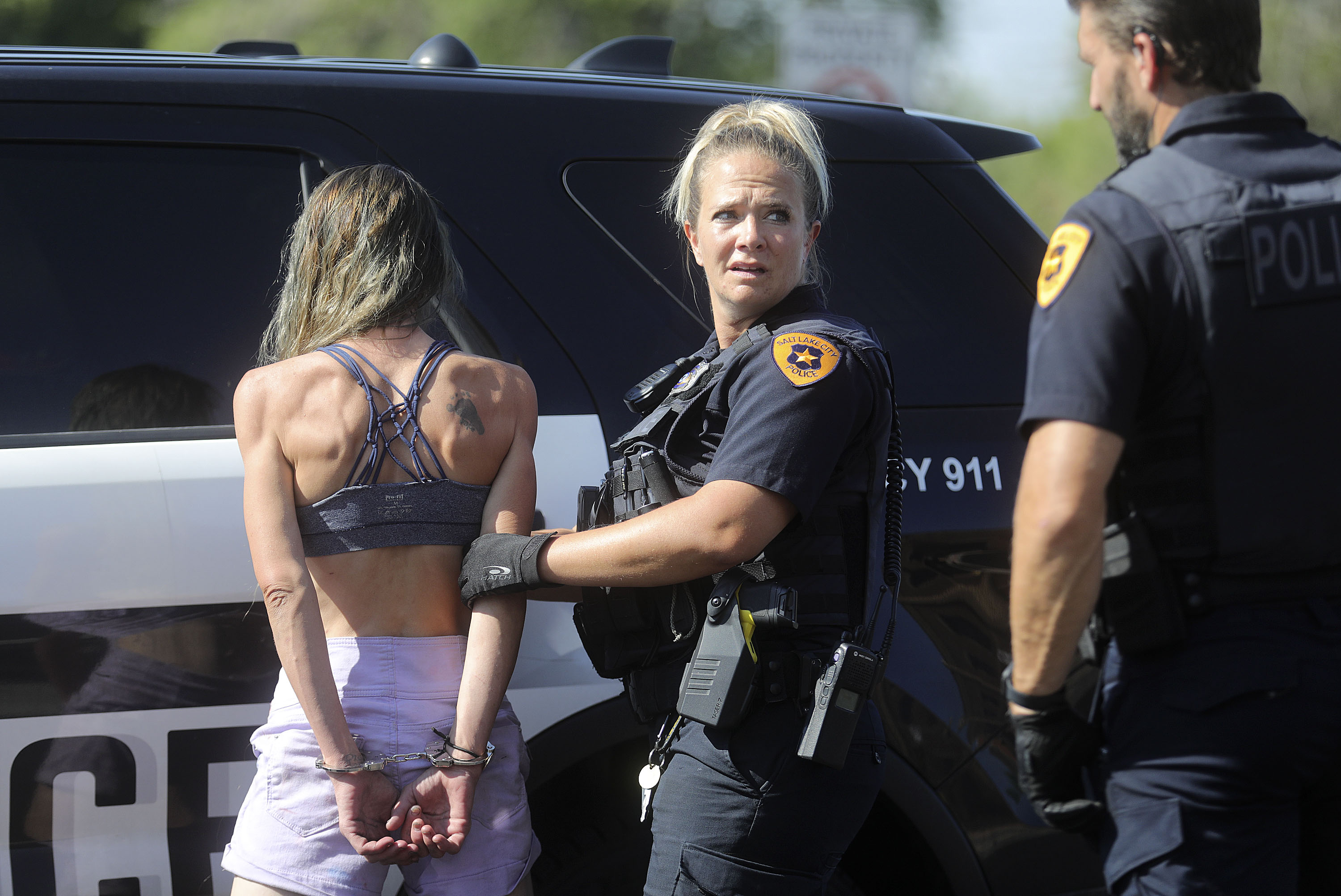 Salt Lake police officer Brandi Palmer takes a woman into custody after she was found trespassing in a stranger's apartment.