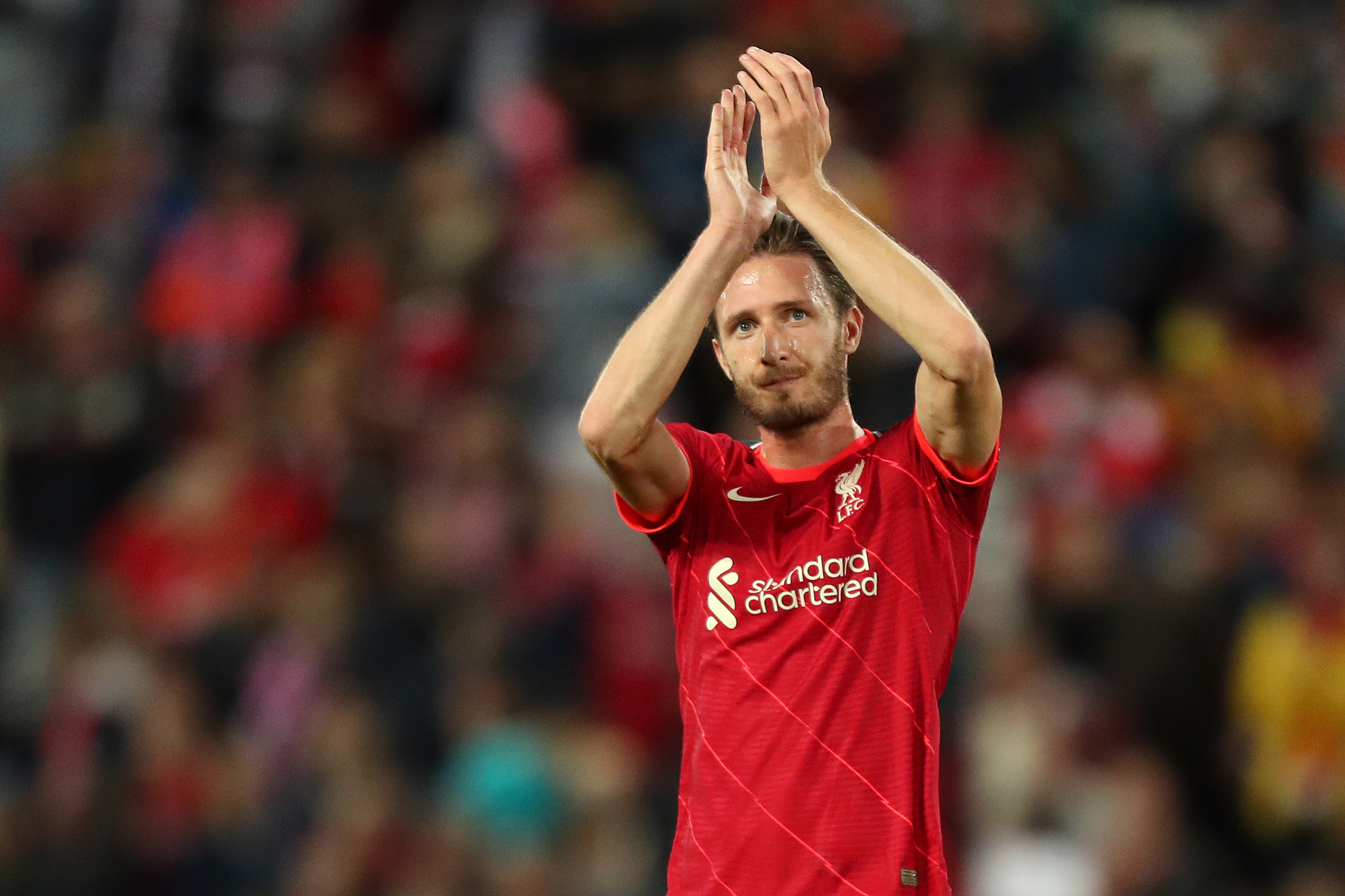 Ben Davies of Liverpool applauds the fans following victory in the Pre-Season Friendly match between Liverpool and Osasuna at Anfield on August 09, 2021 in Liverpool, England.