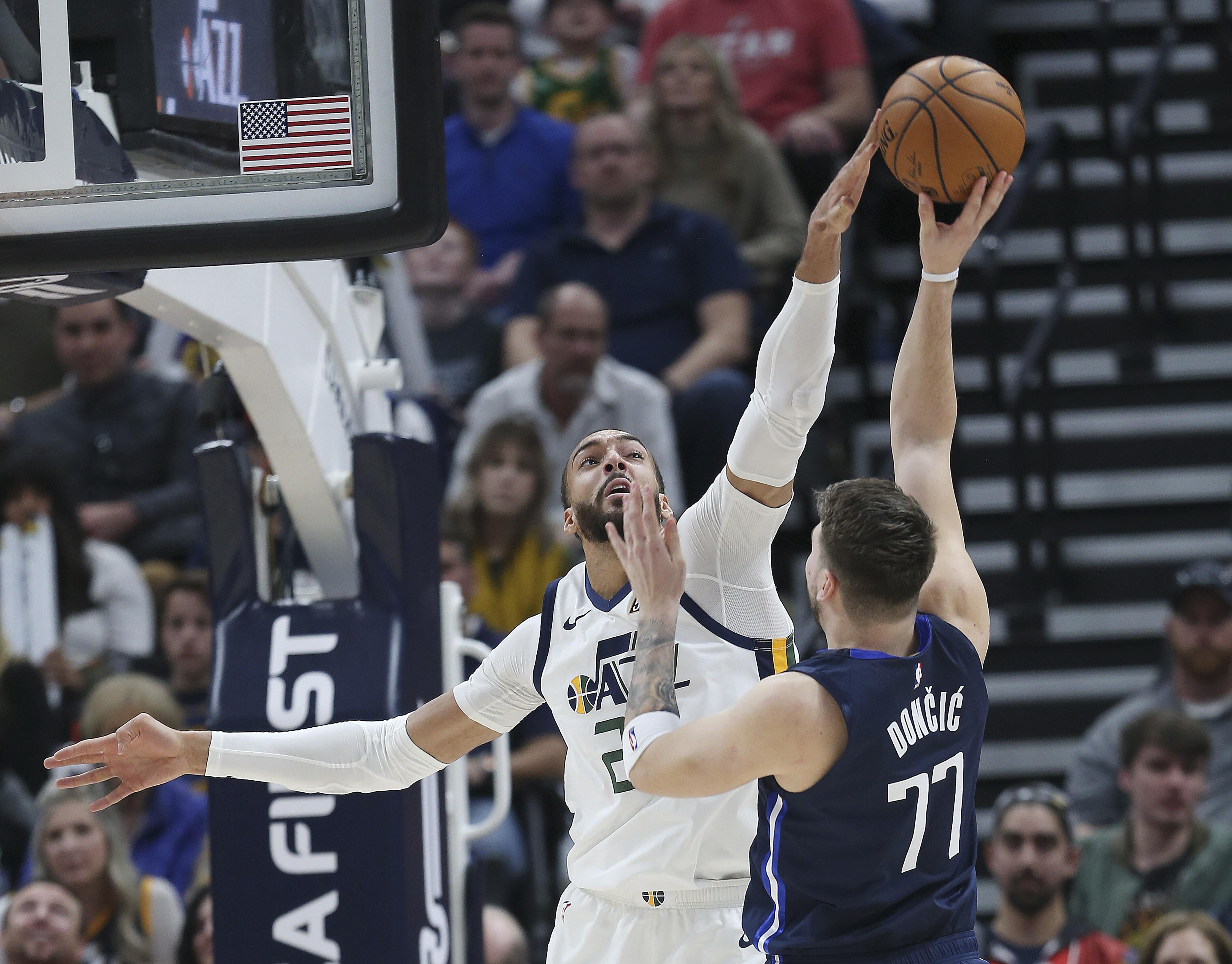 Utah Jazz center Rudy Gobert (27) blocks a shot by Dallas Mavericks guard Luka Doncic (77).