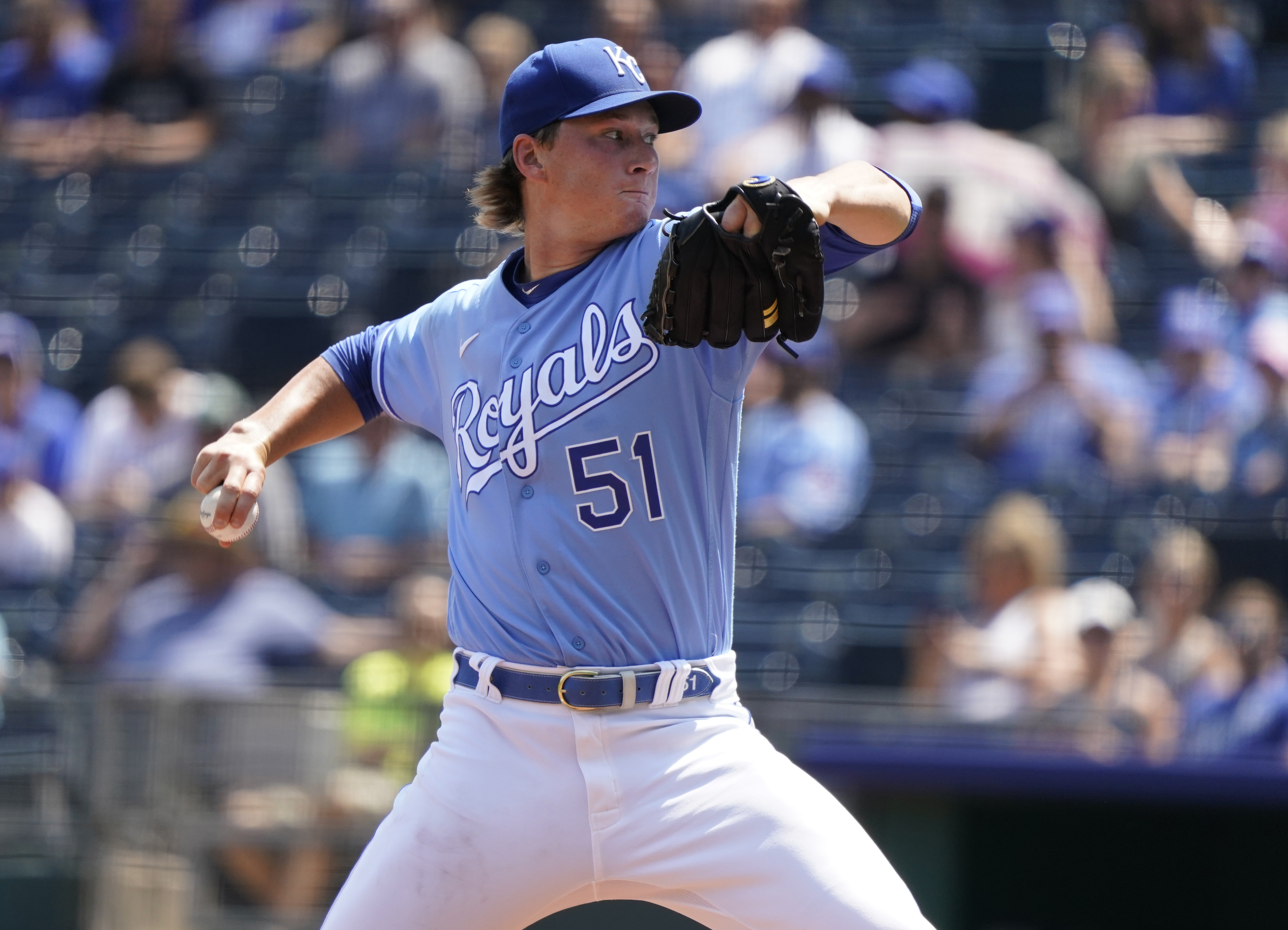 Brady Singer # 51 of the Kansas City Royals throws in the first inning against the New York Yankees at Kauffman Stadium on August 11, 2021 in Kansas City, Missouri.