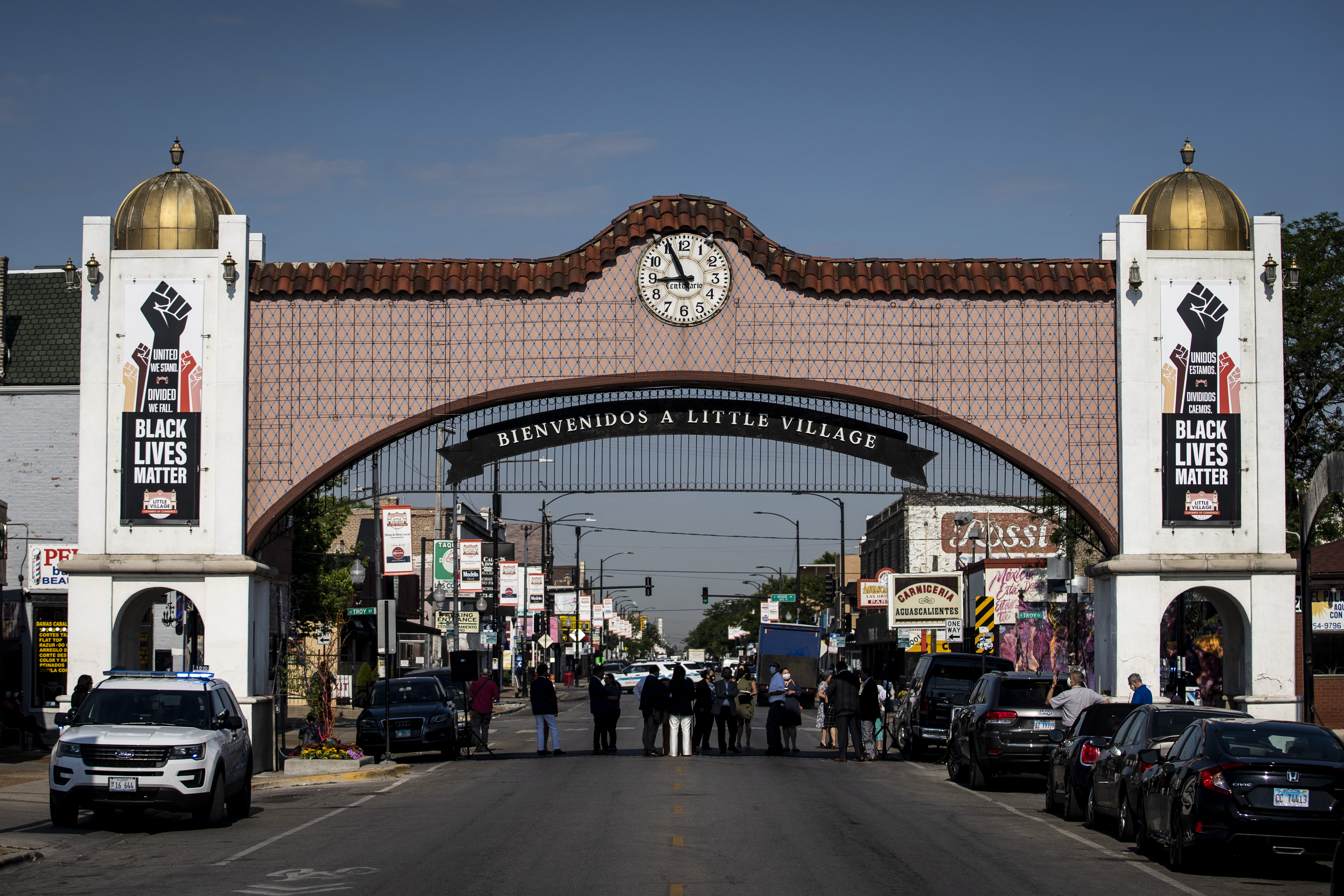 The Little Village Chamber of Commerce unveils four Black Lives Matters banners, displayed on the Little Village neighborhood arch on 26th Street between Troy and Albany, Wednesday morning, June 17, 2020. | Ashlee Rezin Garcia/Sun-Times
