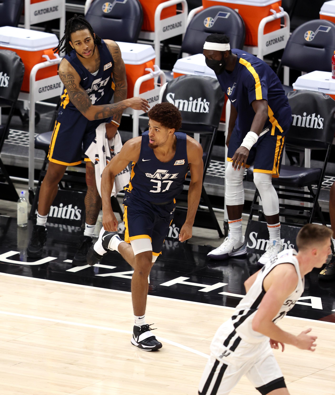 Utah Jazz's Macio Teague turns after dropping in a corner 3