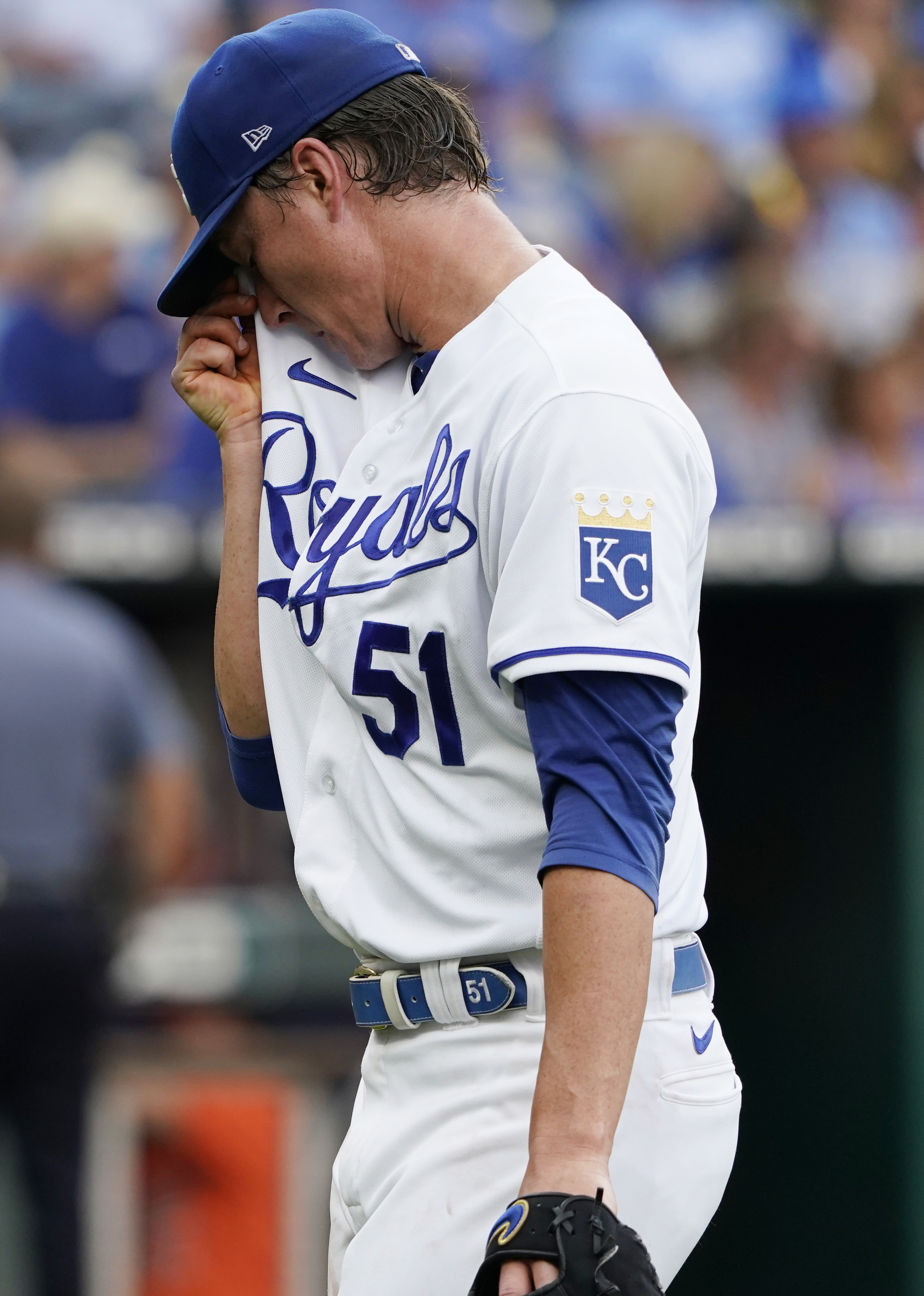 Starting pitcher Brady Singer #51 of the Kansas City Royals leaves a game against the Baltimore Orioles in the third inning at Kauffman Stadium on July 17, 2021 in Kansas City, Missouri.