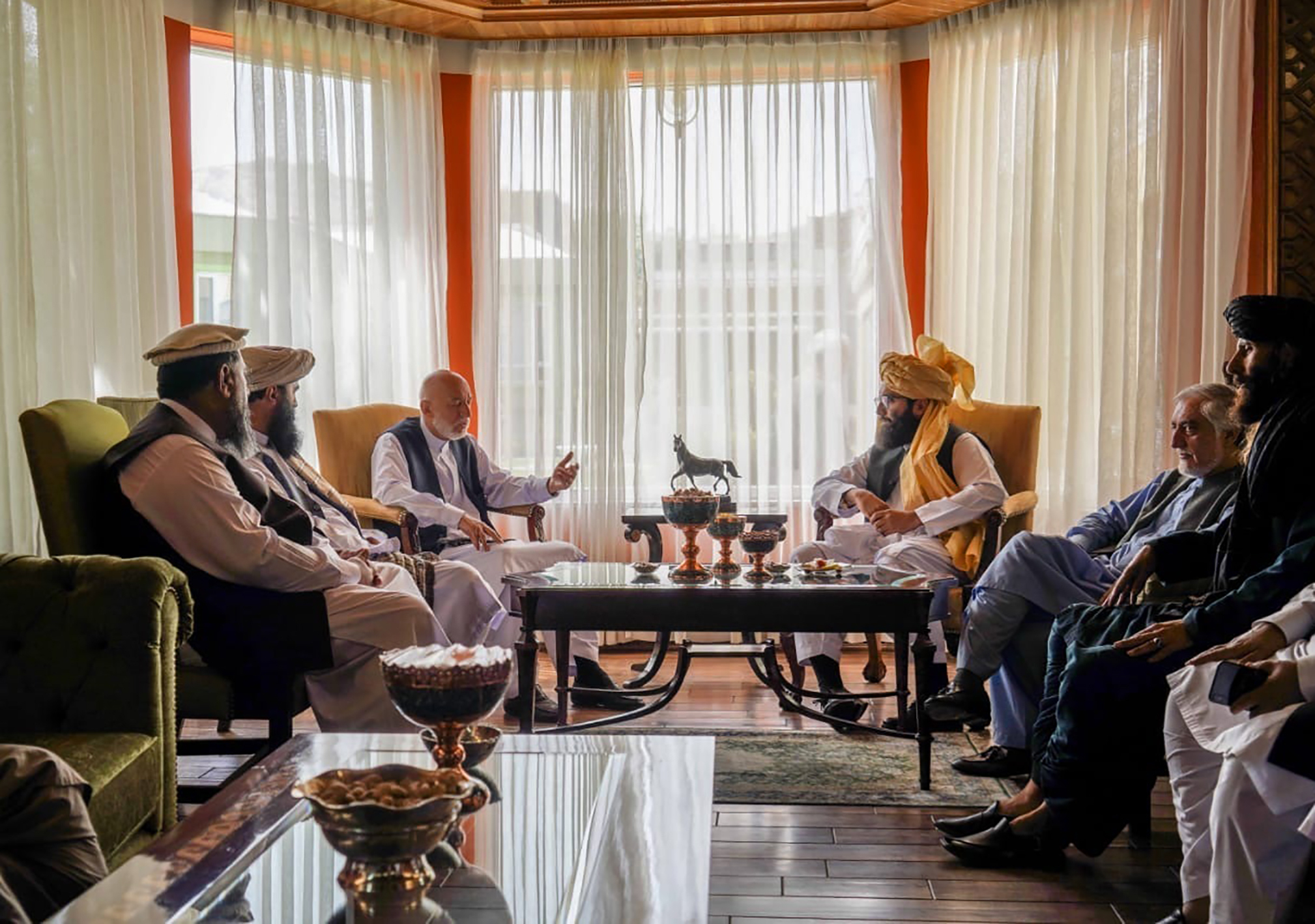 Taliban leaders meet with former President Hamid Karzai in Kabul after a Taliban takeover of the city.