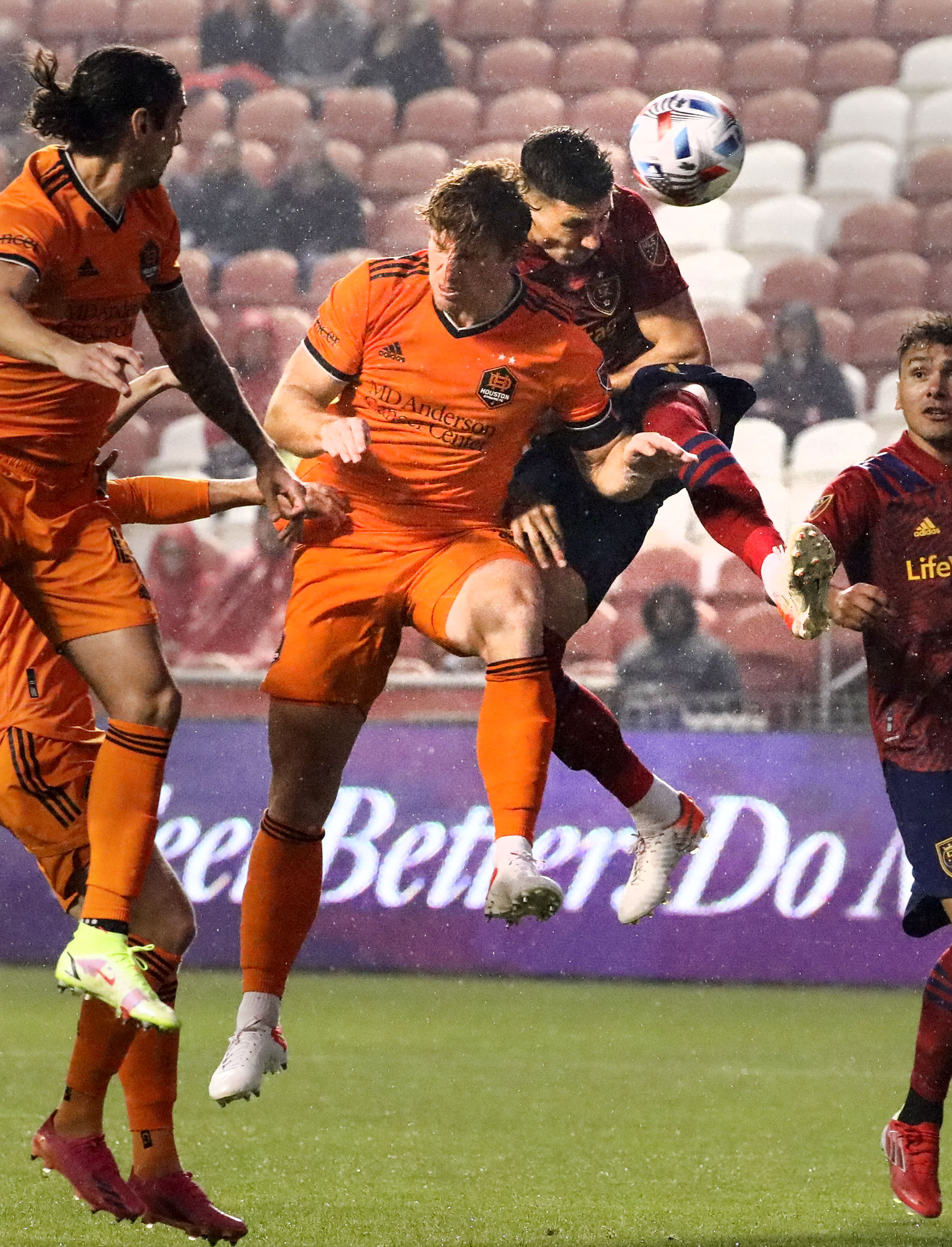 Houston's 5 Tim Parker and Real's 8 Damir Kreilach compete for the ball at Rio Tinto Stadium in Sandy on Wednesday, Aug. 18, 2021.