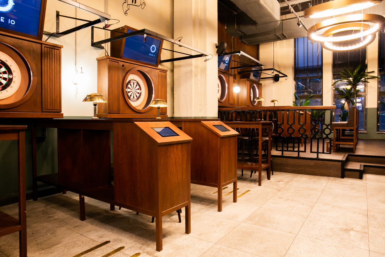 bar with various dart booths in wood