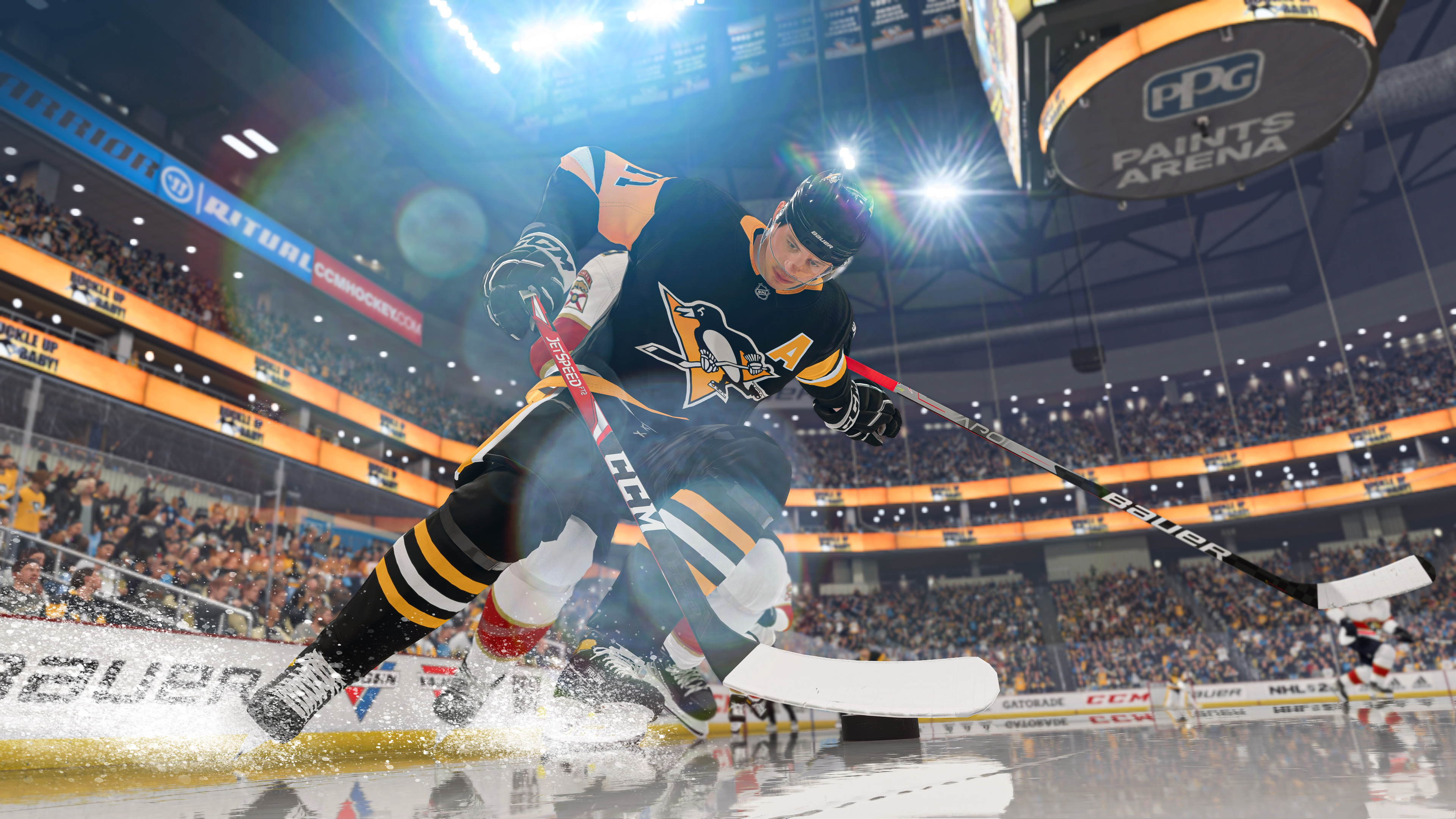 Evgeni Malkin of the Pittsburgh Penguins protects the puck against a member of the Florida Panthers in NHL 22