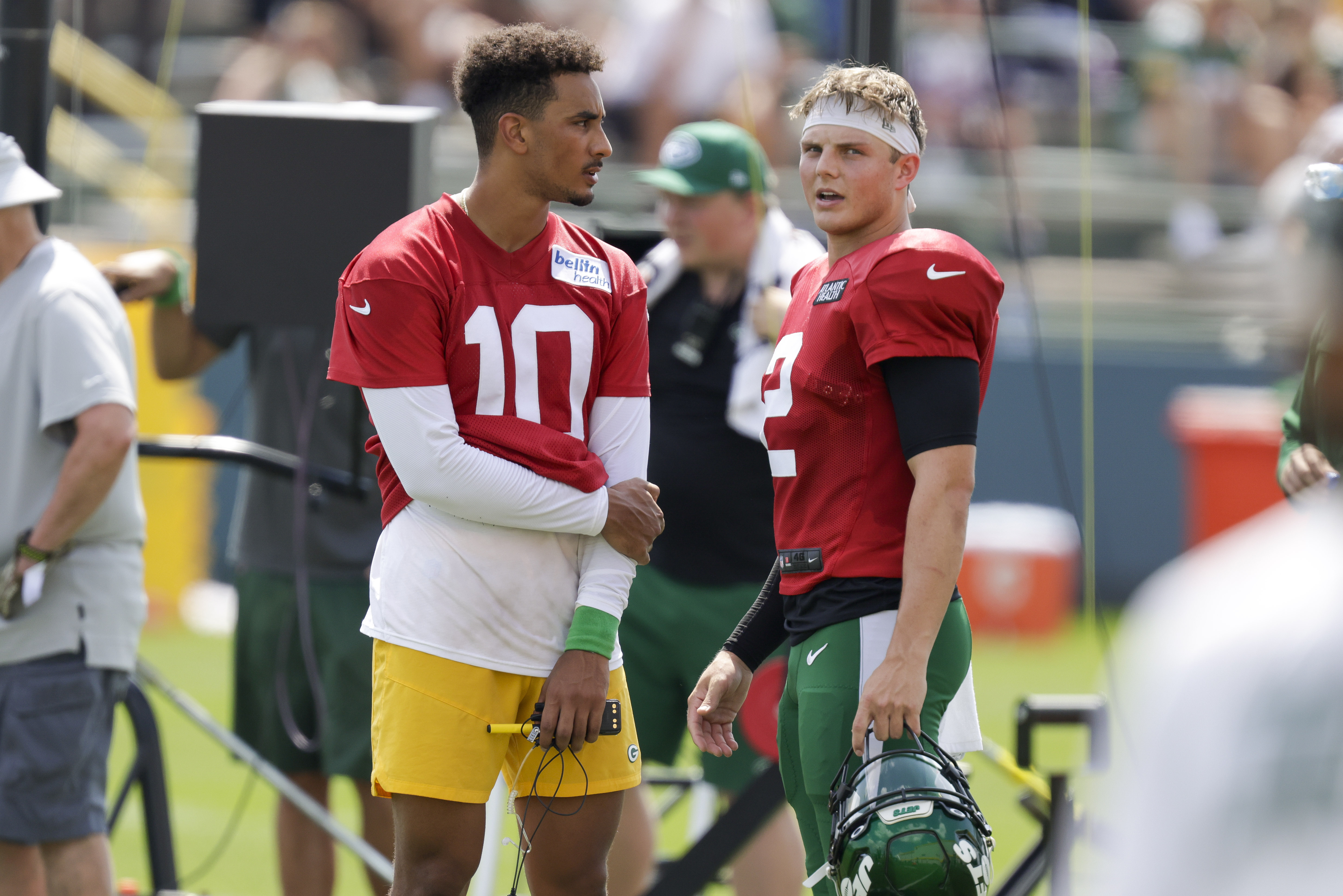 Green Bay Packers quarterback Jordan Love and New York Jets quarterback Zach Wilson during a joint NFL football training camp practice.