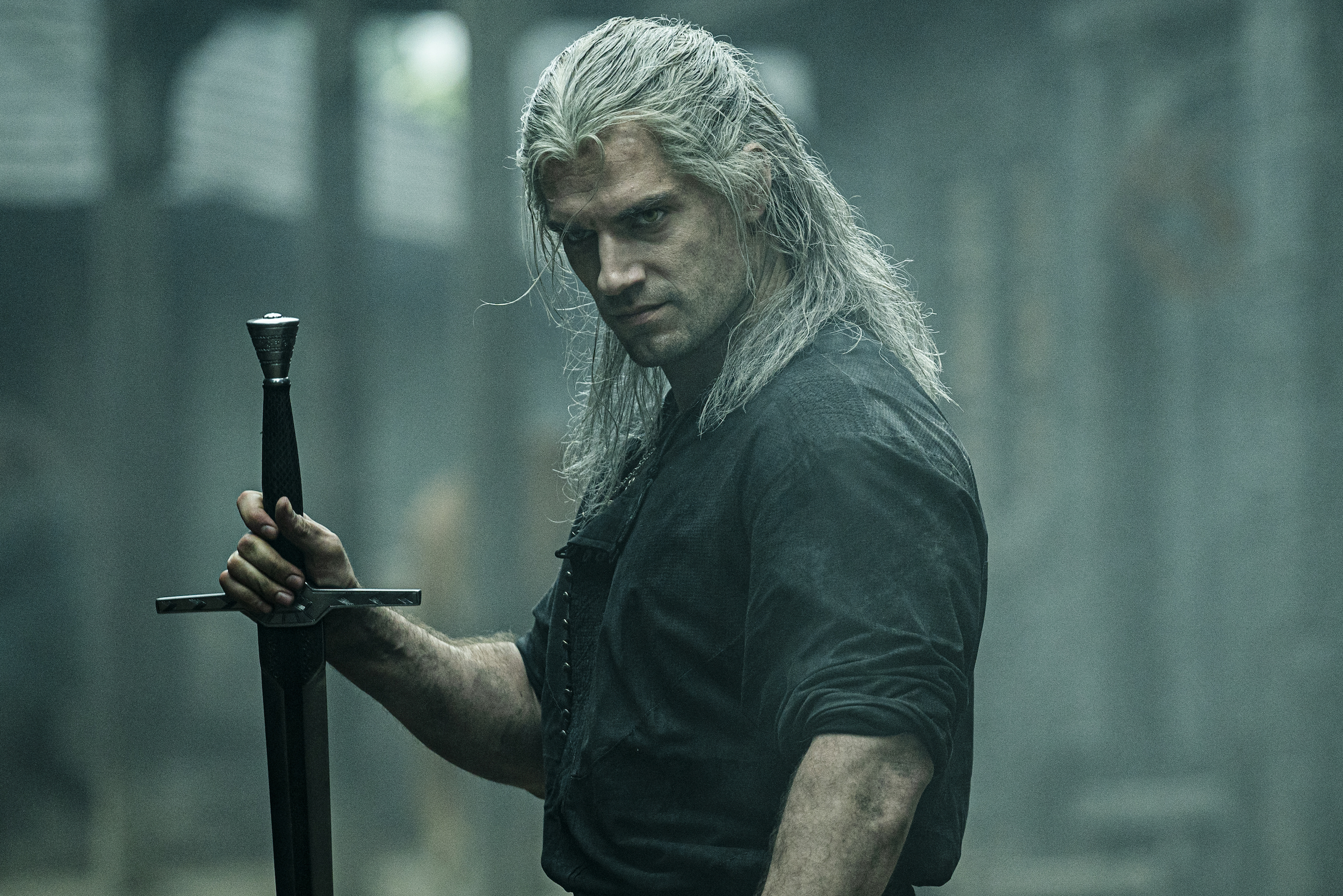 The Witcher holds his sword