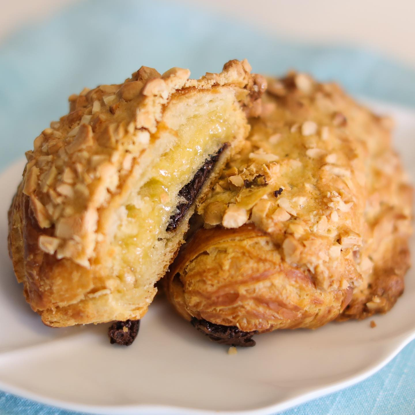 a flaky pastry topped with crushed almonds and cut in half