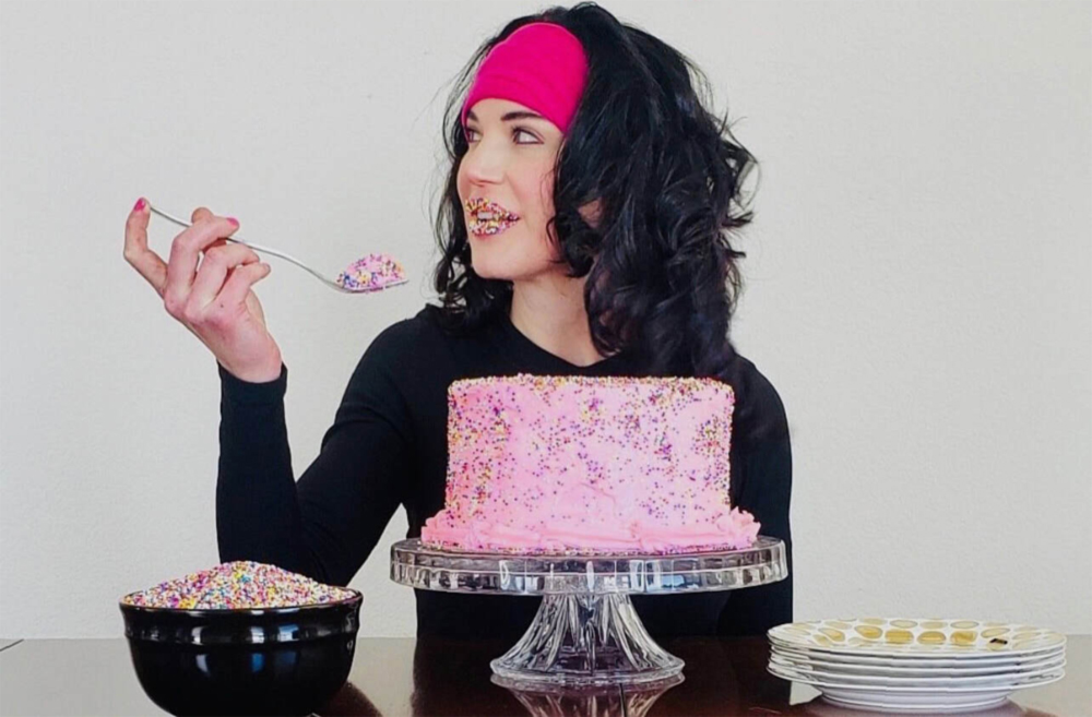 The Cake Slice owner Michelle Obenrader-Kitchen with one her 8 inch cake creations.