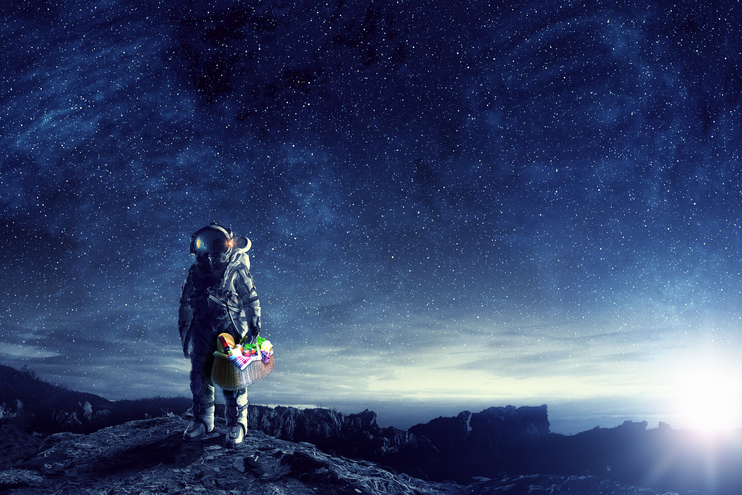 An illustration of an astronaut carrying a picnic basket on a barren planetary landscape with a sky full of stars.