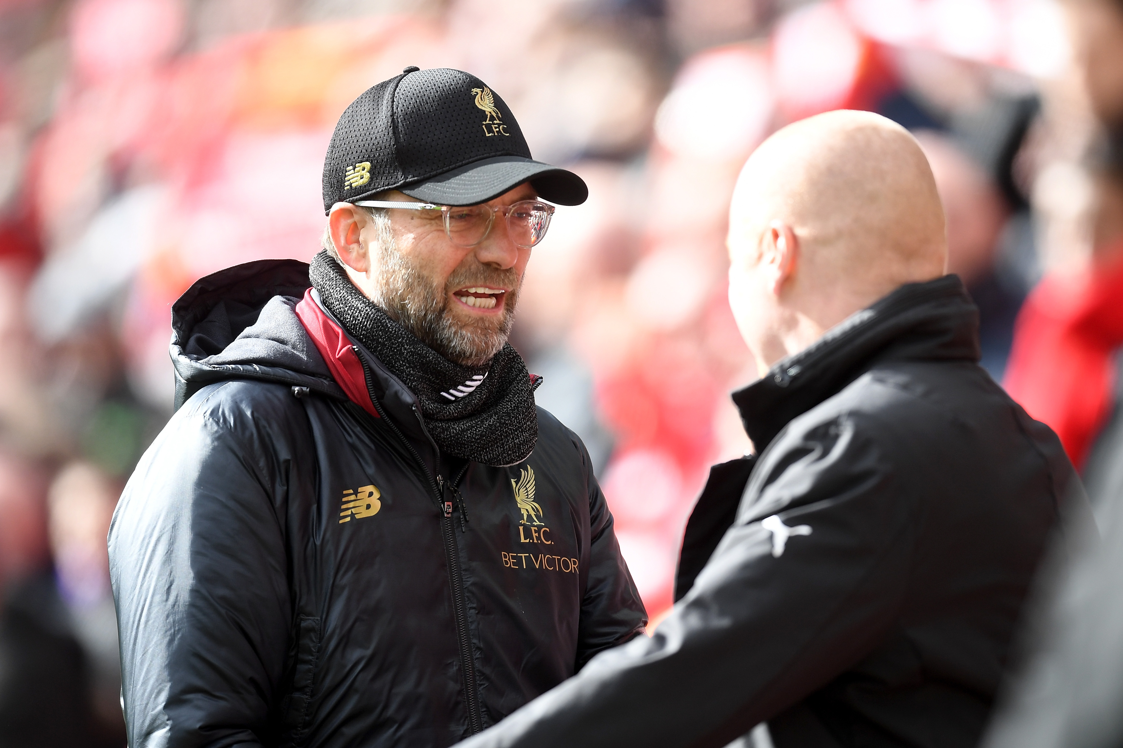 Jurgen Klopp, manager of Liverpool shakes hands with Sean Dyche, manager of Burnley