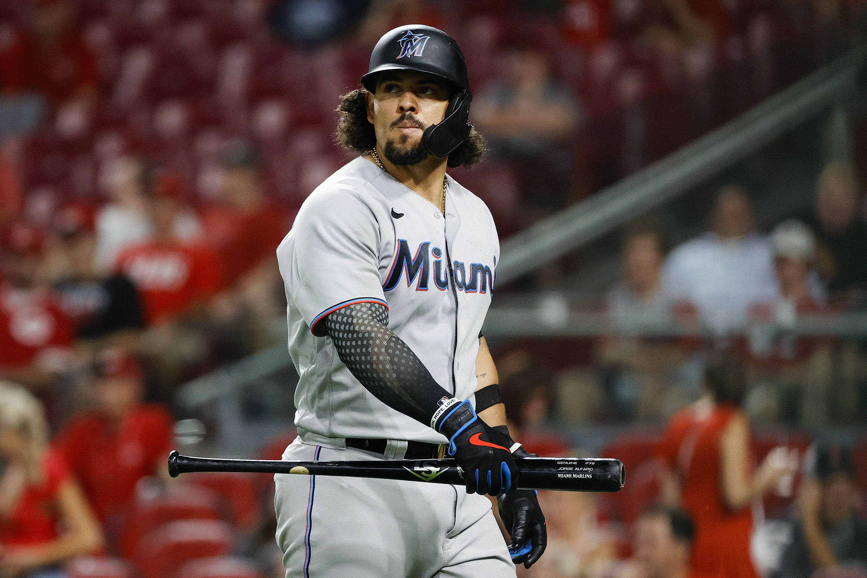 Jorge Alfaro #38 of the Miami Marlins looks on during the ninth inning against the Cincinnati Reds at Great American Ball Park