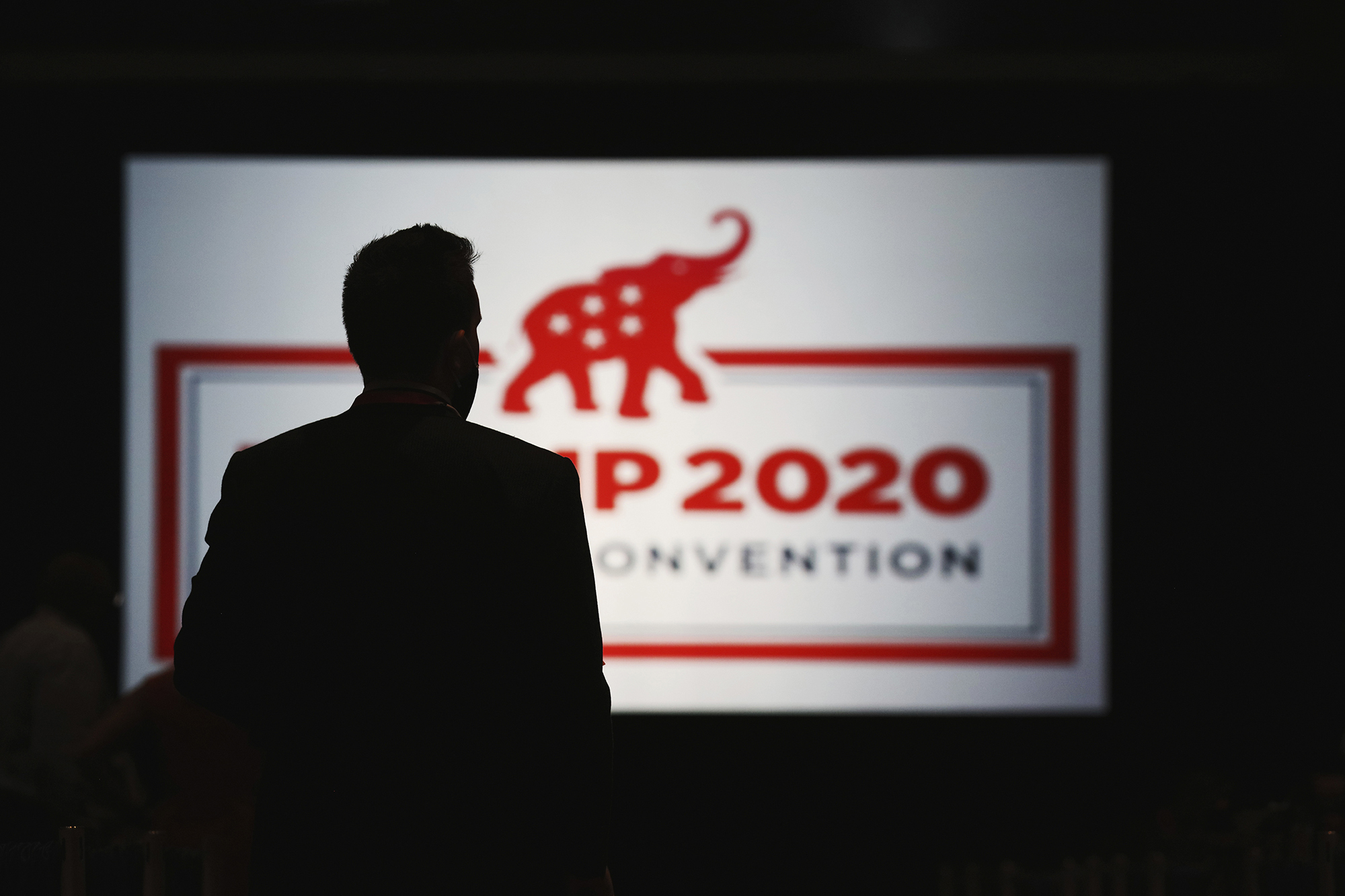 In this Aug. 24, 2020, file photo, delegates arrive for the first day of the Republican National Convention in Charlotte, N.C.