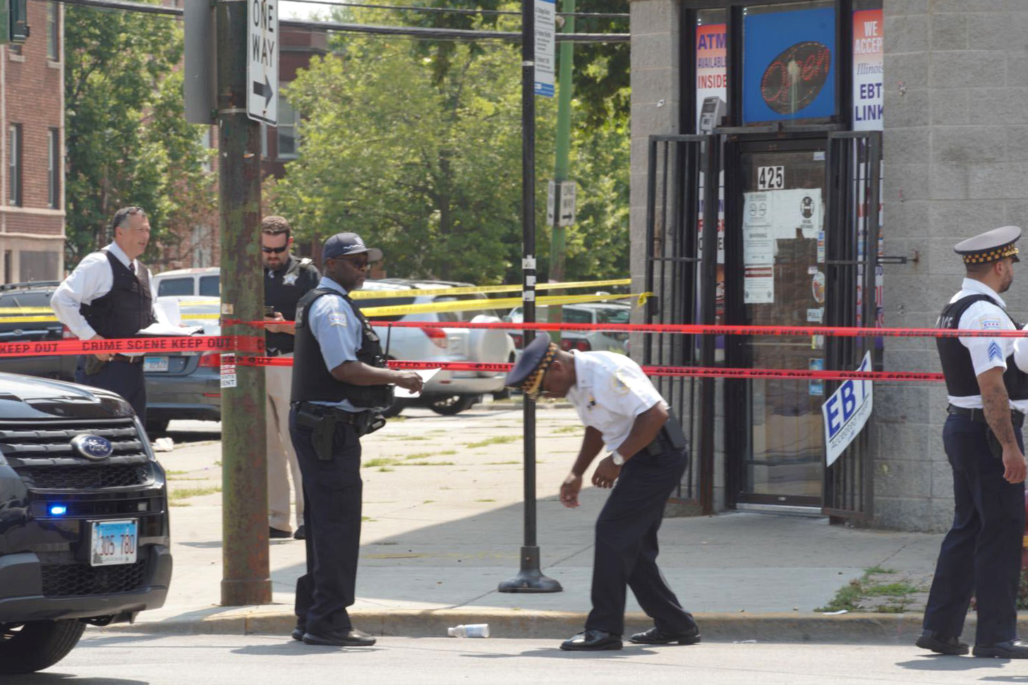 Chicago police investigate Friday afternoon in the 400 block of East 111th Street, where a 9-year-old boy and a man were both shot in Roseland.